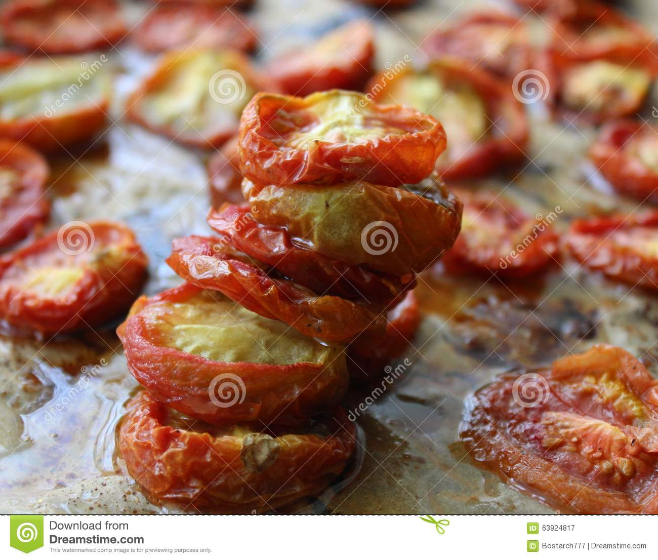 Homemade oven baked dried tomatoes in olive oil stock for Dry roasted tomatoes