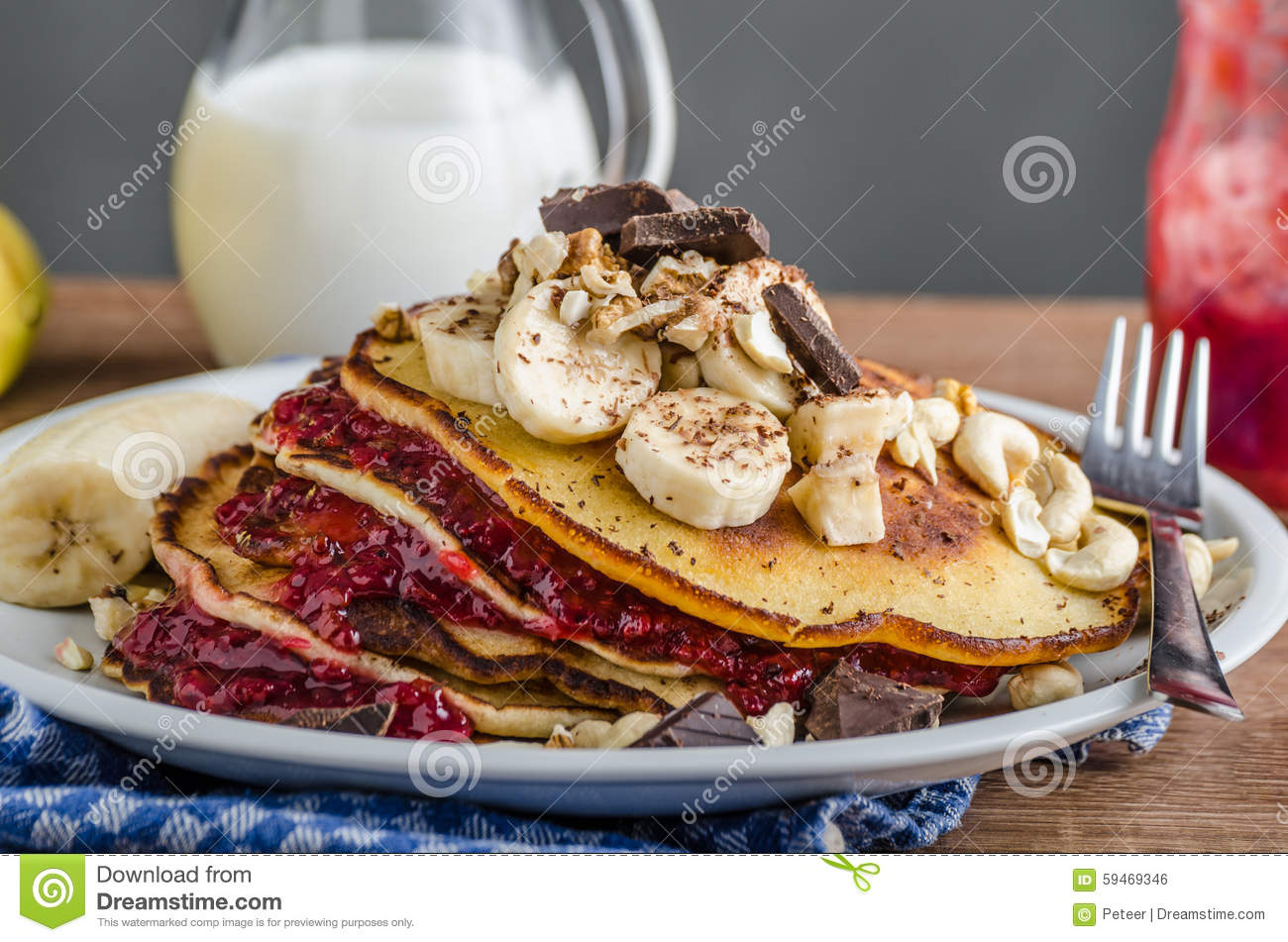 Homemade pancakes with currant jam, banana and chocolate, roasted ...
