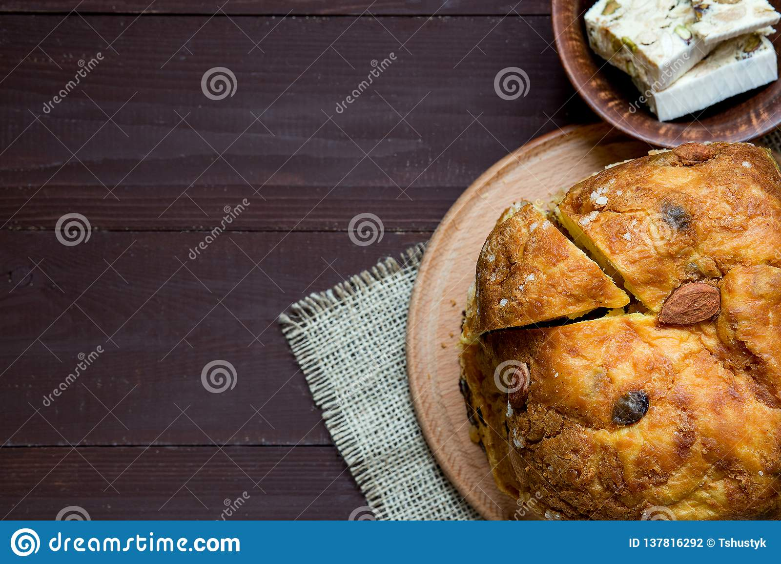Homemade panettone, italian traditional Christmas cake on brown background, close up, top view, copy space