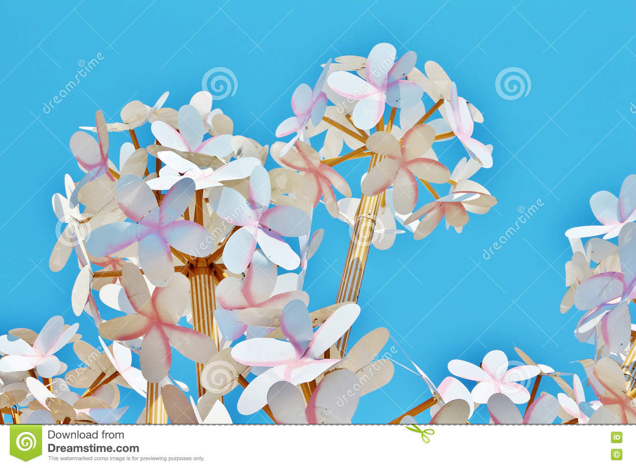 Homemade paper flowers on a background of bright blue sky stock download comp mightylinksfo