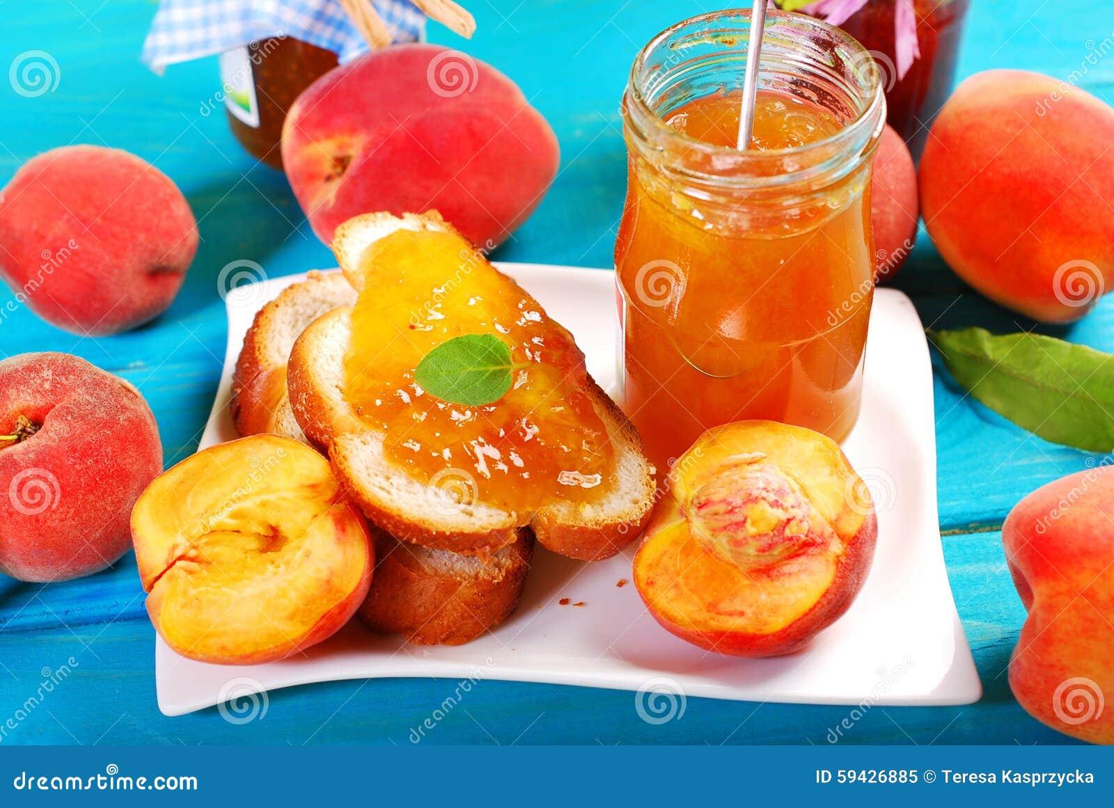 Homemade preserves-jar of peach jam,sweet bakery and fresh fruits on ...