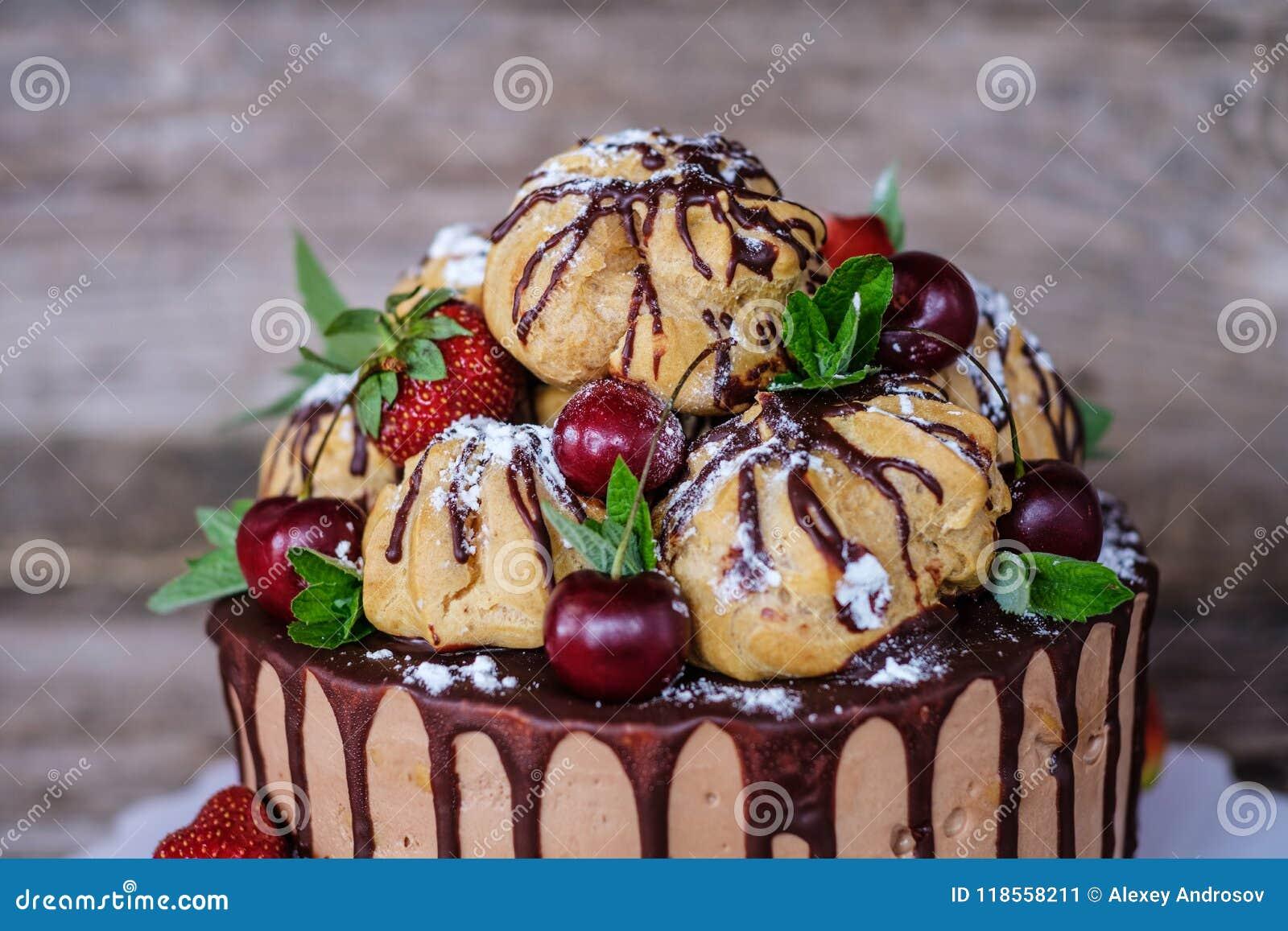 Homemade profiterole cake with strawberries and cherries