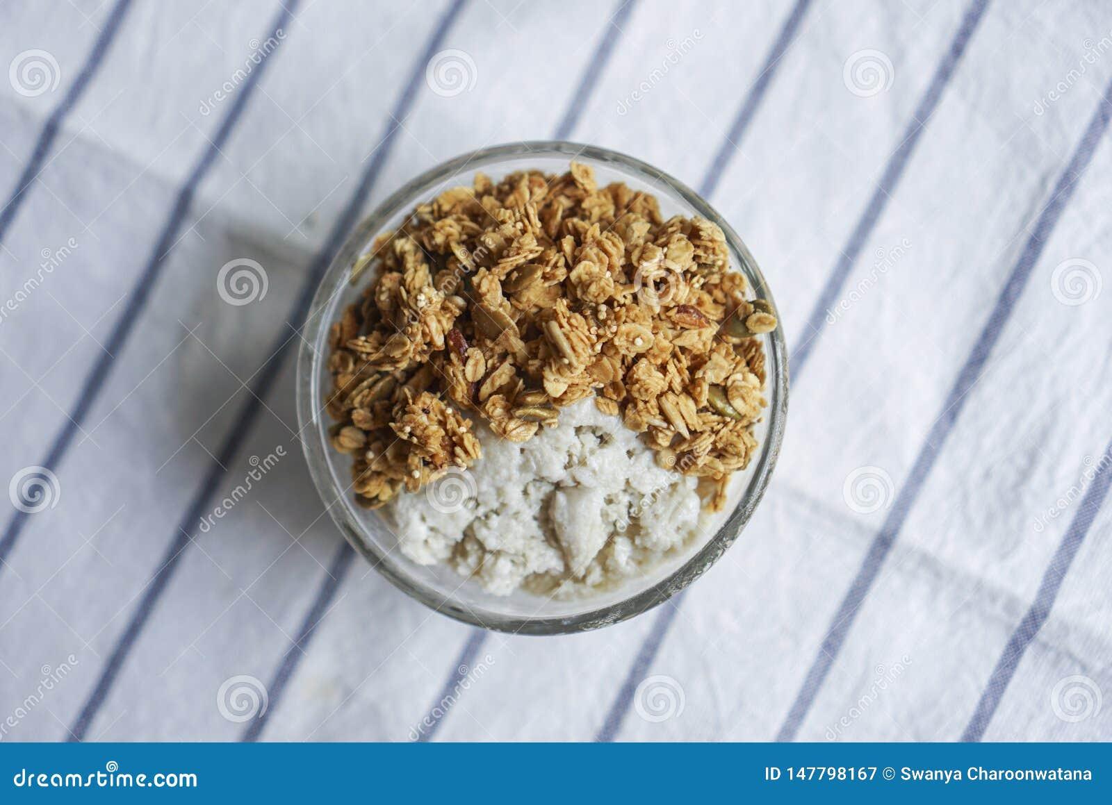 A bowl of healthy parfait, homemade granola.