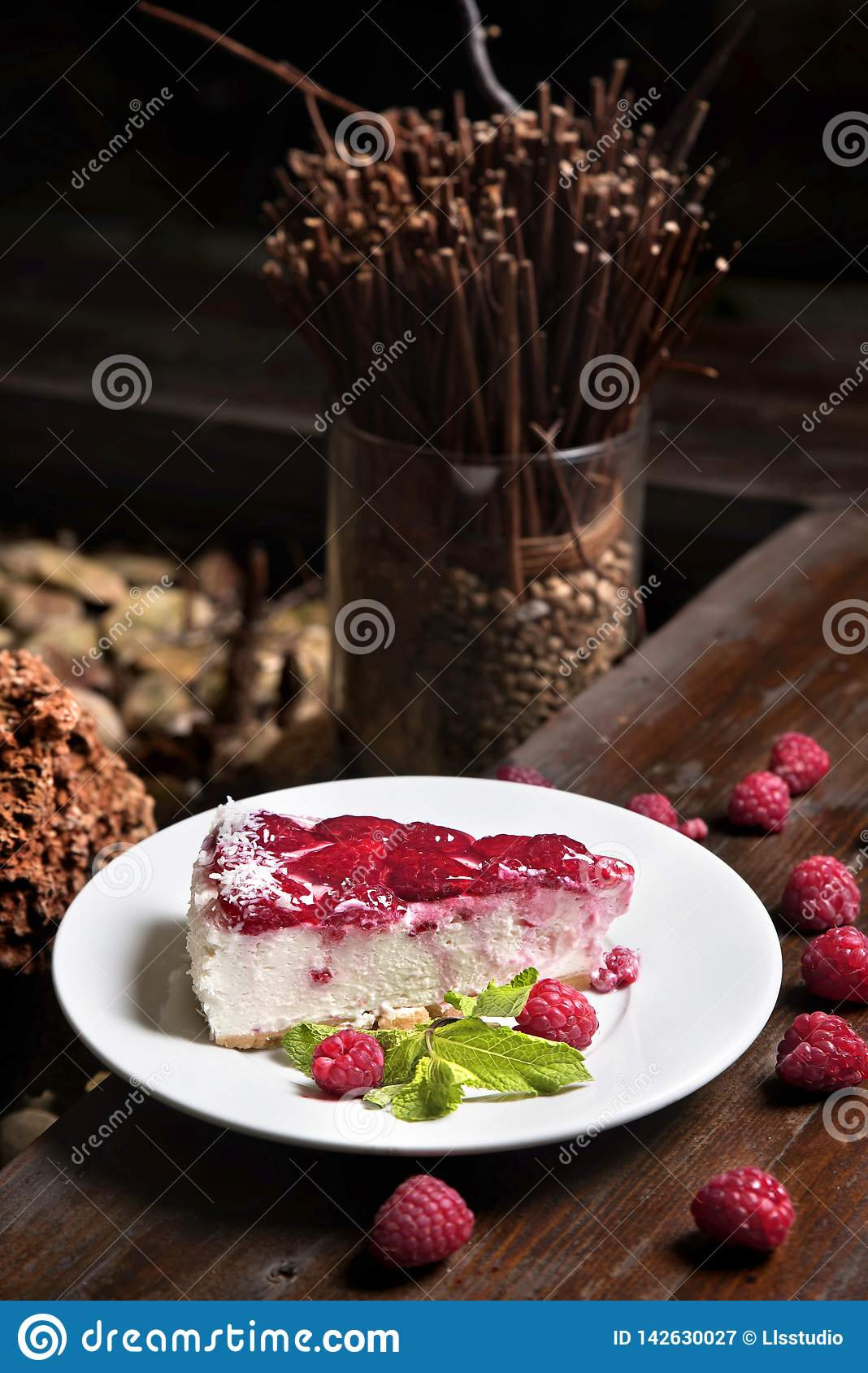 Homemade Raspberry Cheesecake with mint and berries.