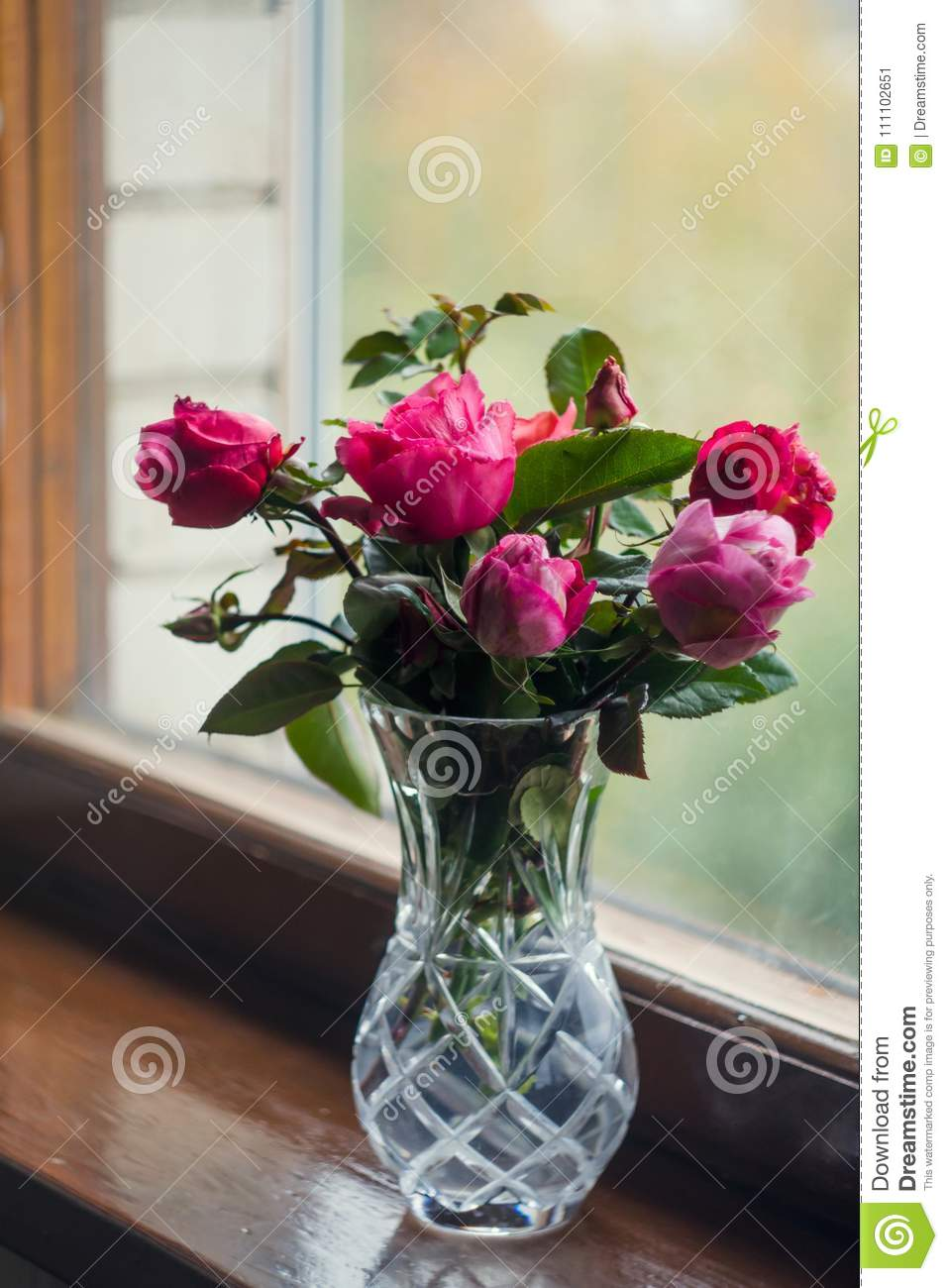 Homemade Roses Bouquet In A Crystal Vase On A Wooden Window The