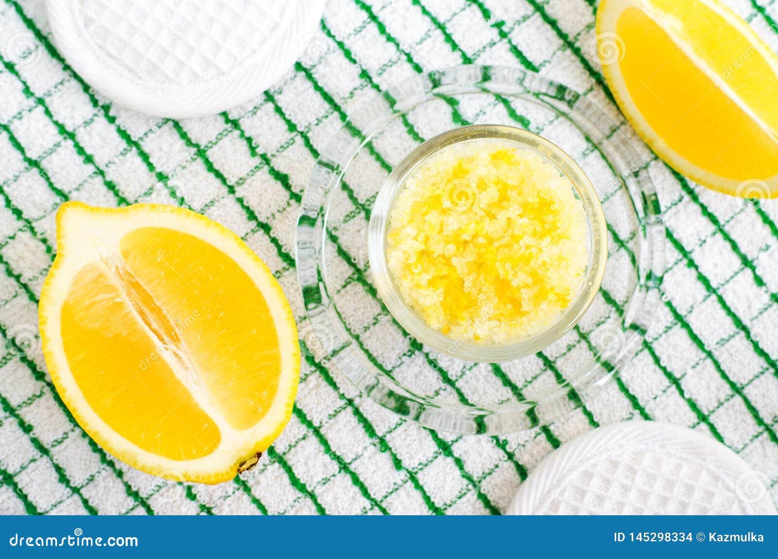 Homemade scrub foot soak or bath salt with lemon juice and zest, sea salt and olive oil. DIY beauty treatments and spa recipe.