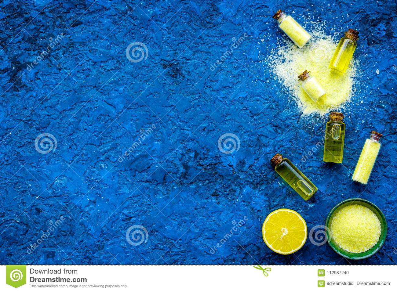 Homemade spa with lemon salt in natural cosmetic set on blue background top view space for text