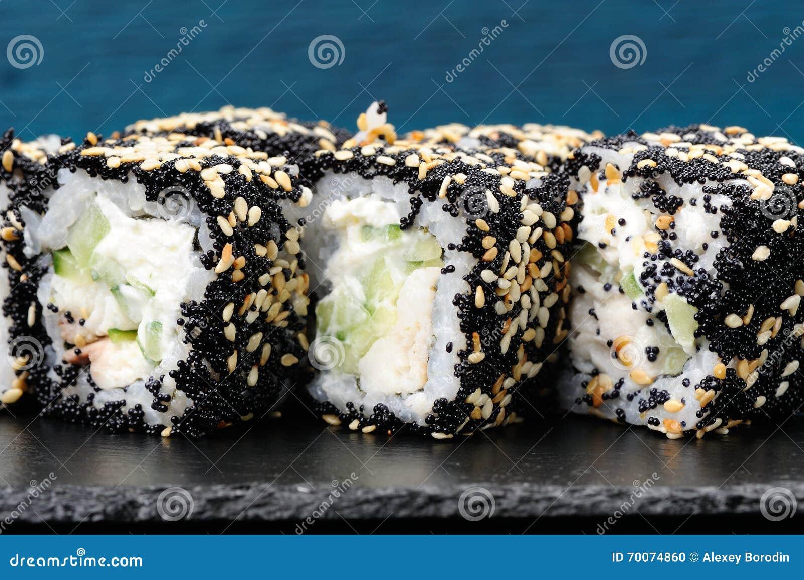 Homemade Sushi Rolls With Black Tobiko Sesame Seeds