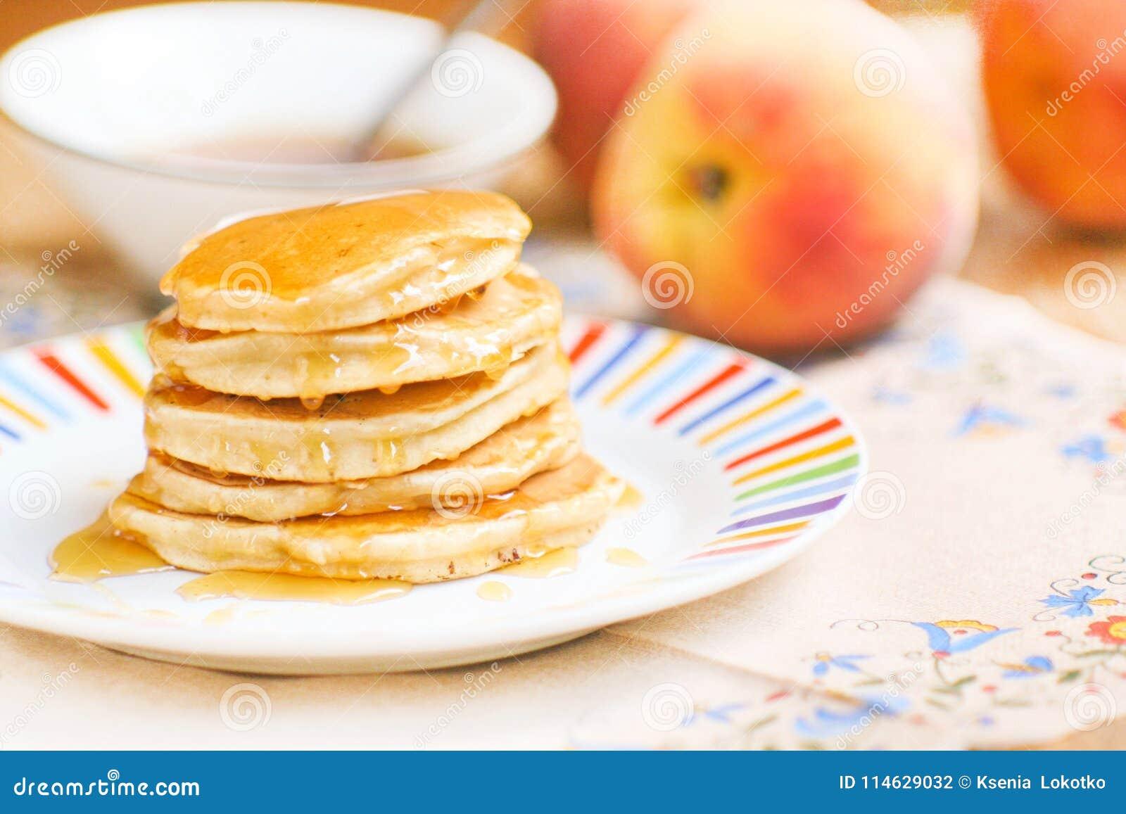 Homemade sweet pancakes with honey