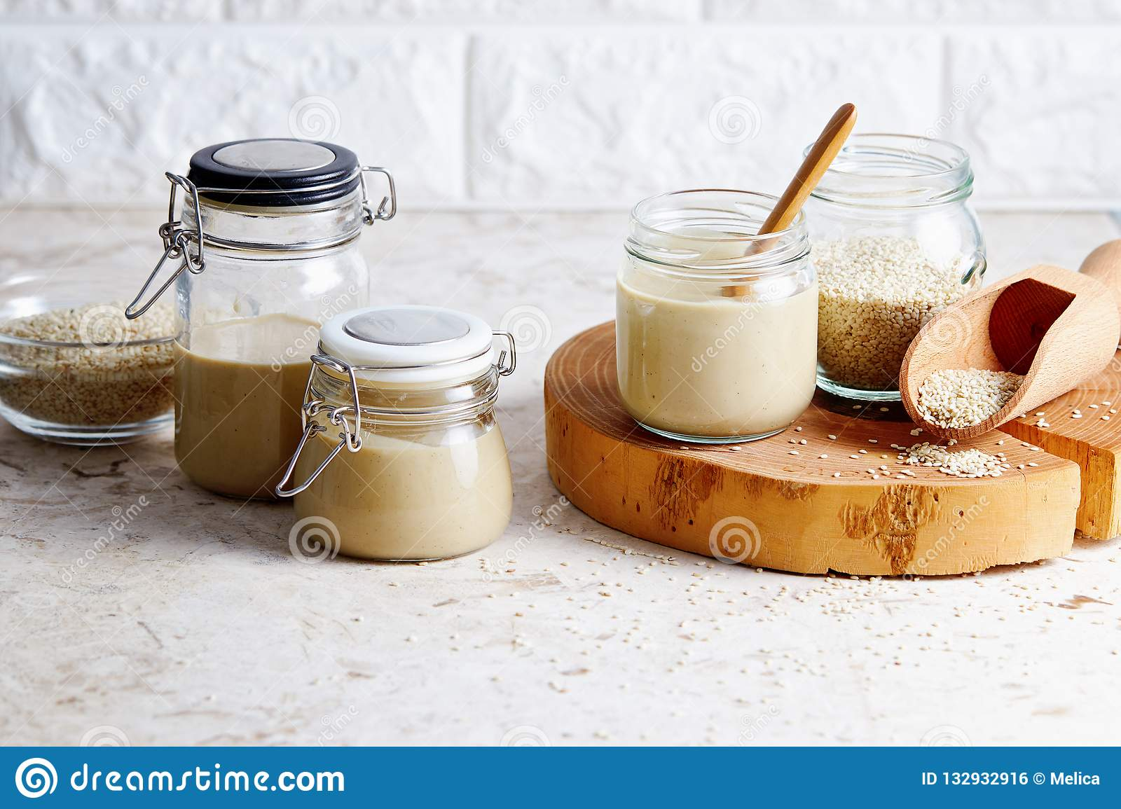 Homemade tahini in glass jars