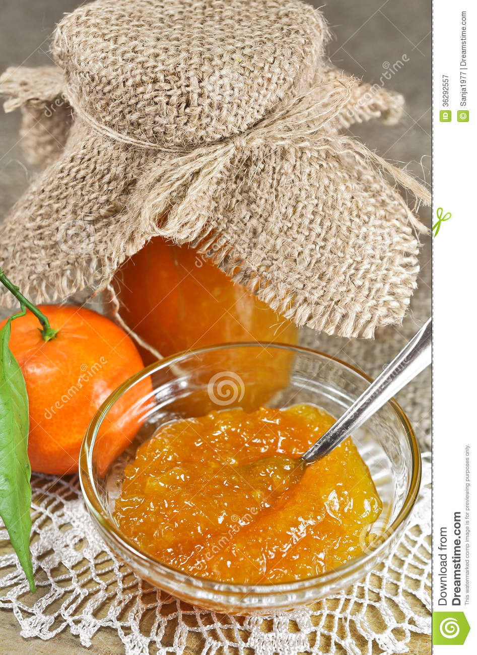 Homemade tangerine jam or marmalade with a fresh tangerine, on a jute ...