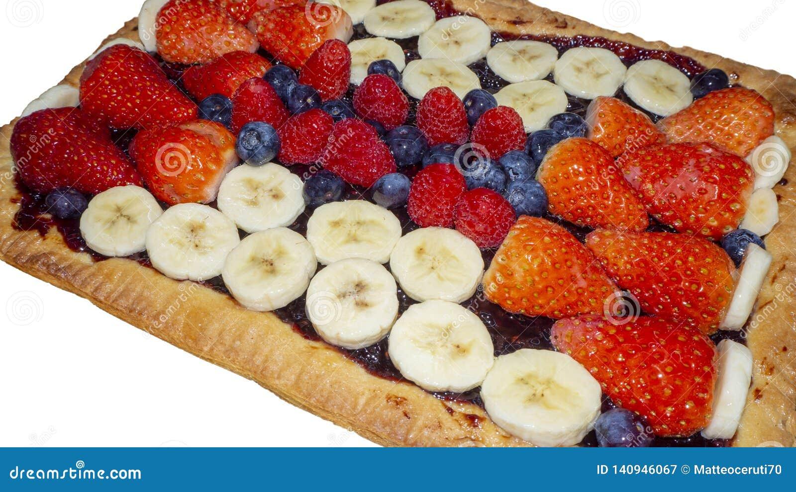Homemade tart with fresh fruit, strawberries, bananas, blueberries and raspberries