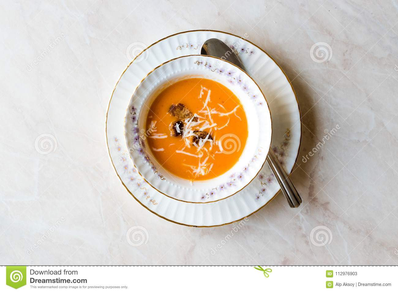 Homemade Tomato Soup with Croutons and Cheese.
