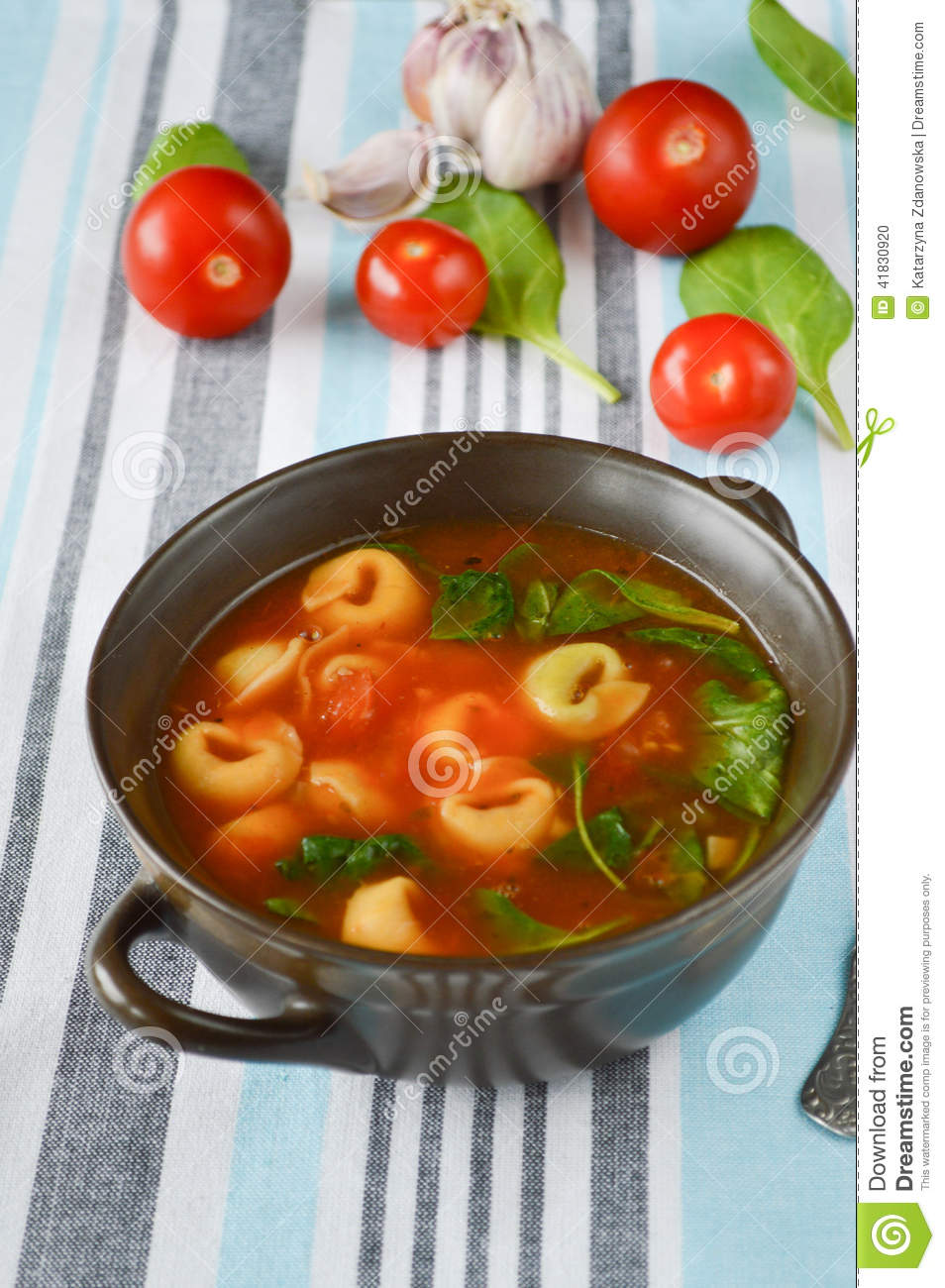 Homemade Tortellini Soup With Tomato, Basil, And Spinach Stock Photo ...