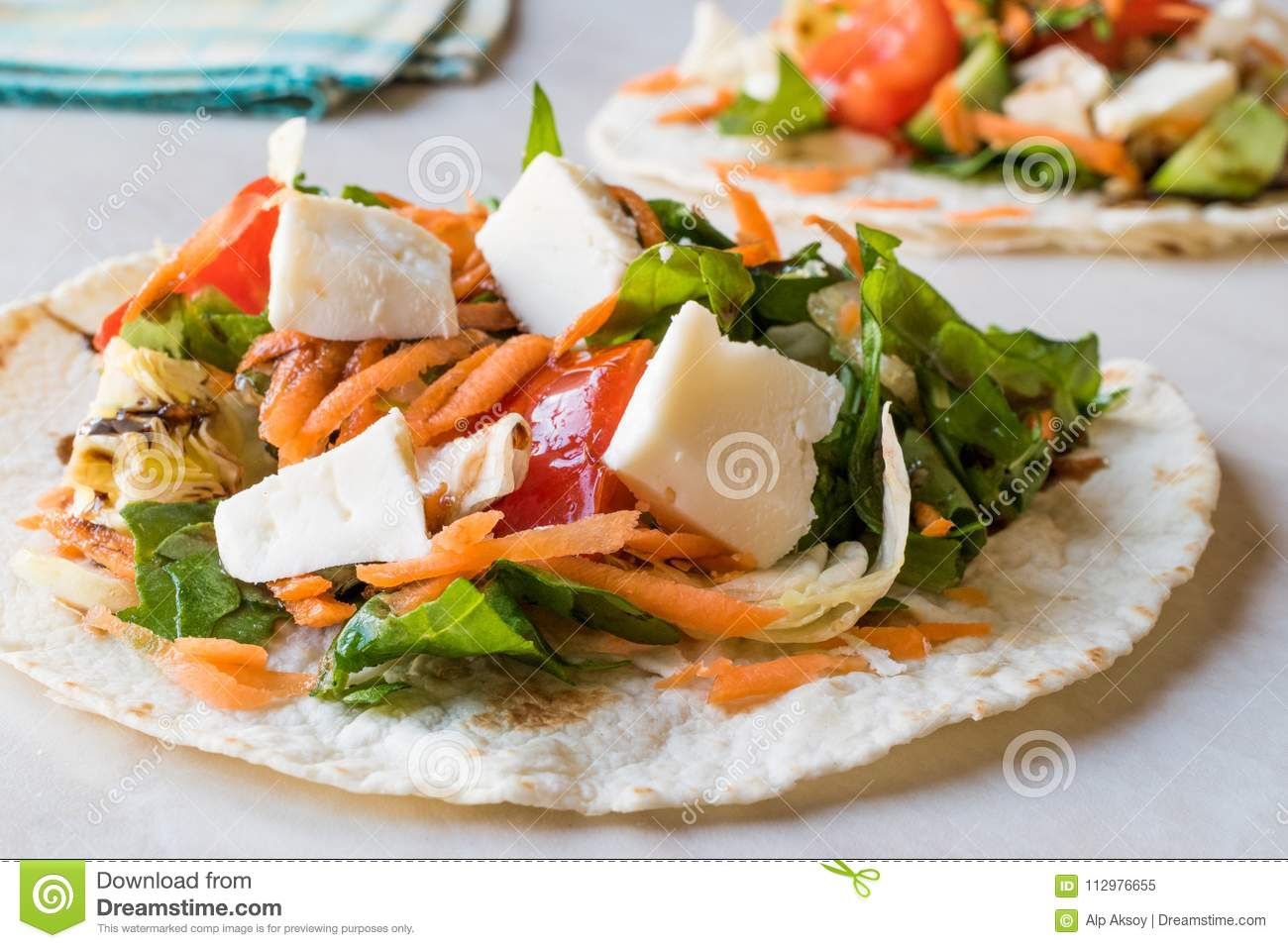 Homemade Vegetarian Tostadas with Salad, Cheese and Grated Carrot Slices.