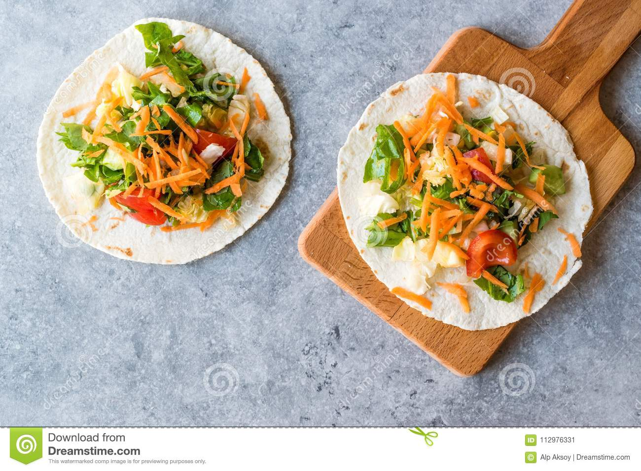 Homemade Vegetarian Tostadas with Salad and Polished Carrot Slices.
