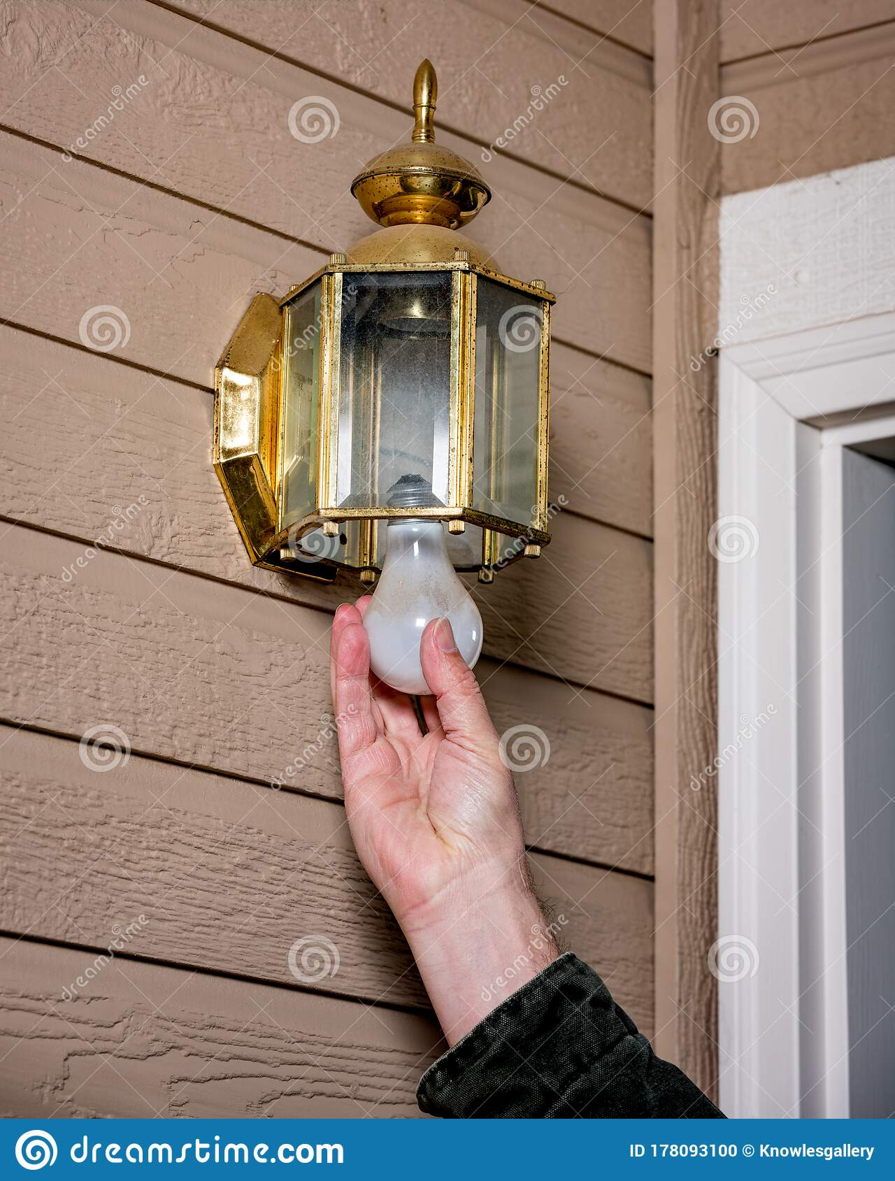 Homeowner Replaces A Light Bulb In An Outdoor Light Fixture Stock Photo Image Of Removal Repairman 178093100