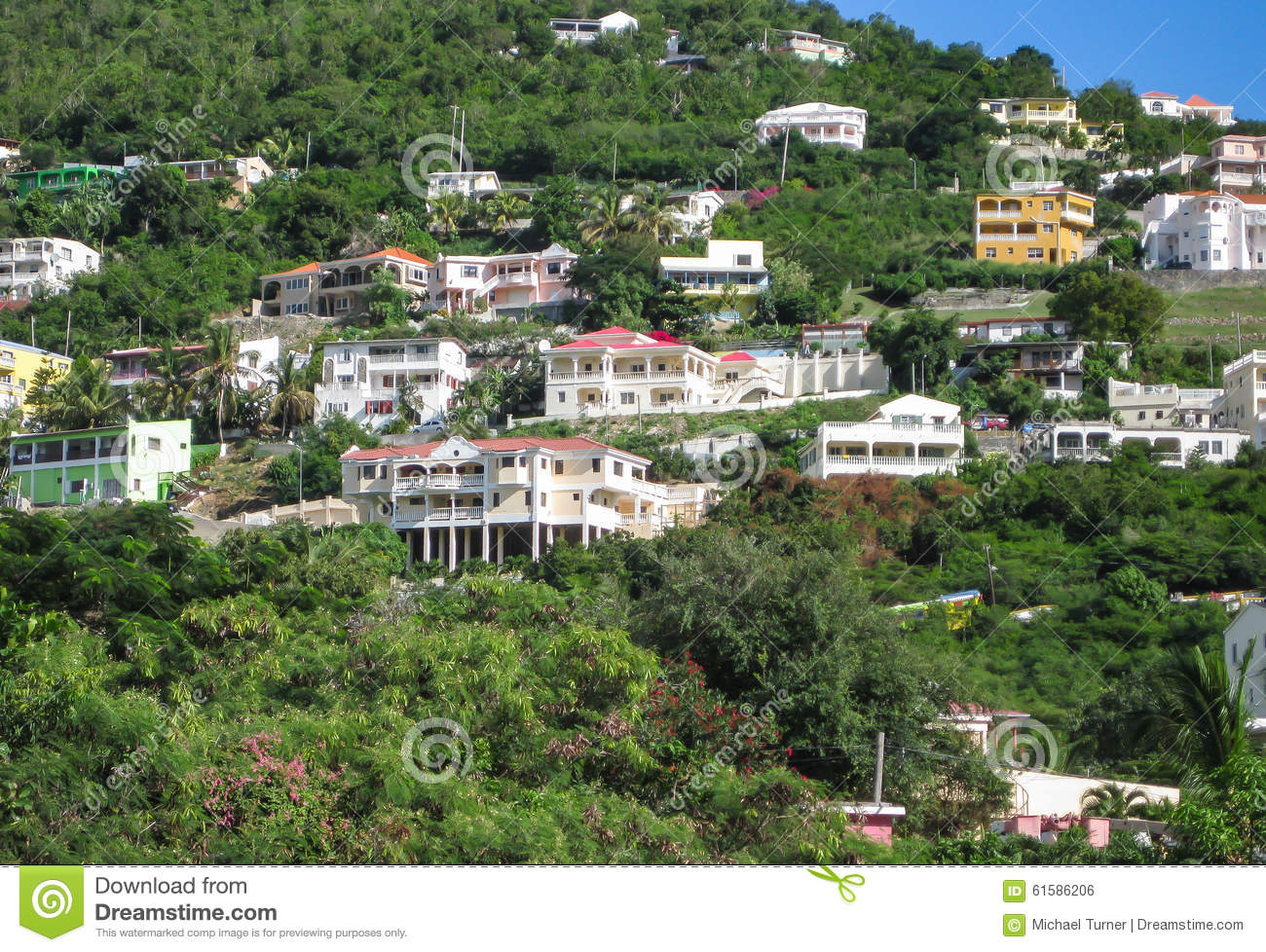 Grand case st martin december 28 2009 homes are nestled along the hillside in the french town of grand case on this small caribbean island