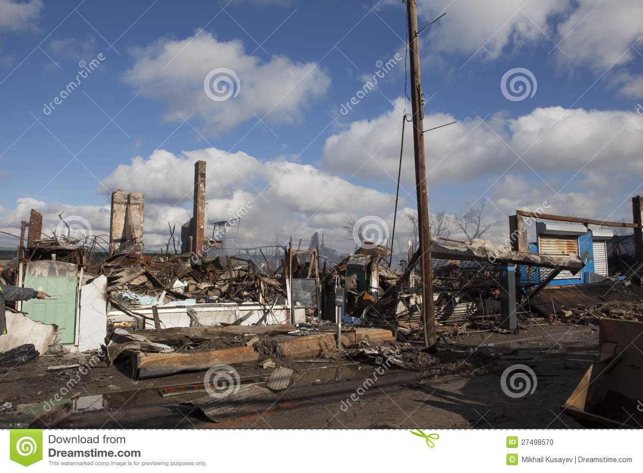 Homes sit smoldering after Hurricane