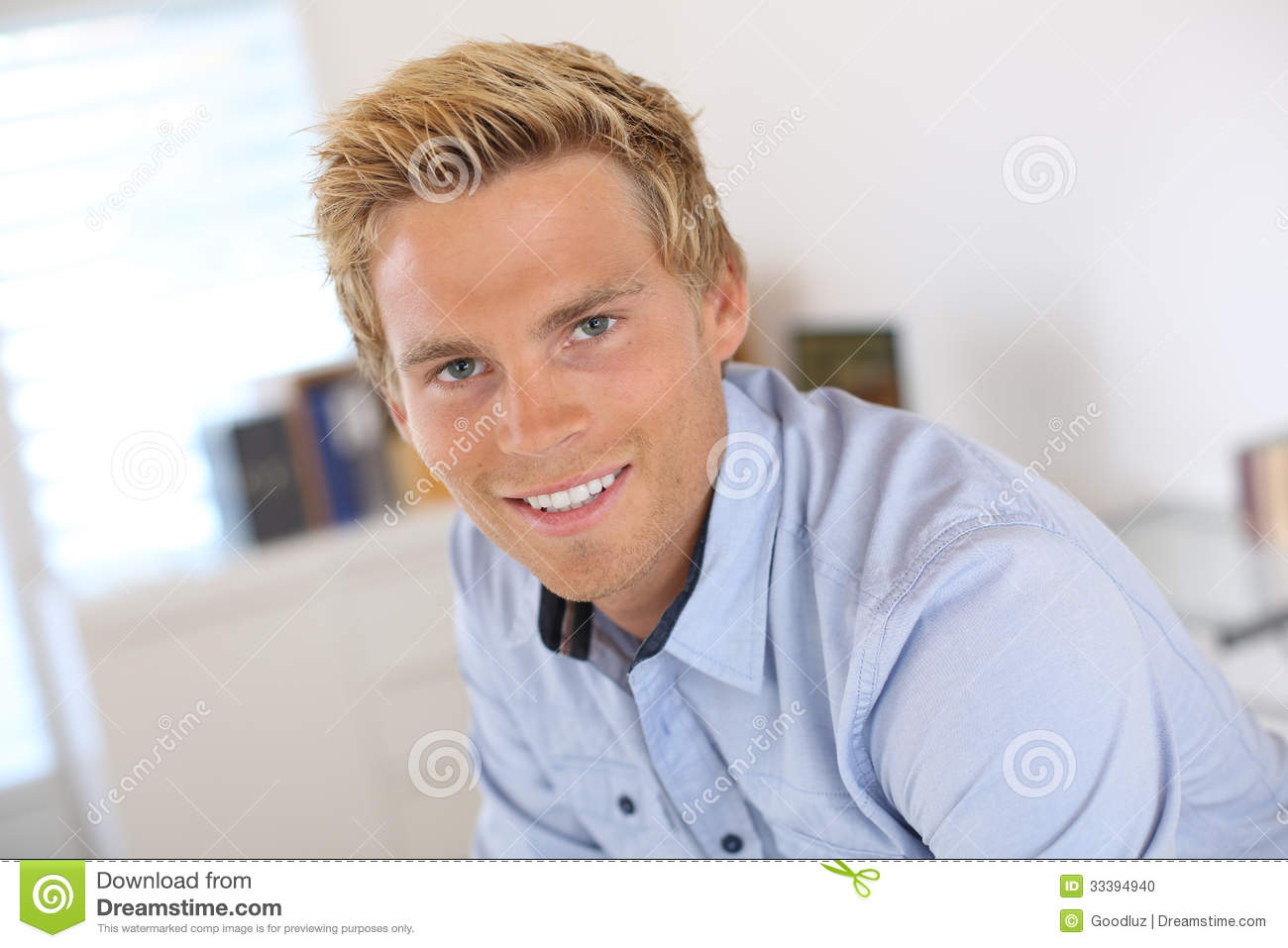 13 boy with blonde hair and blue eyes