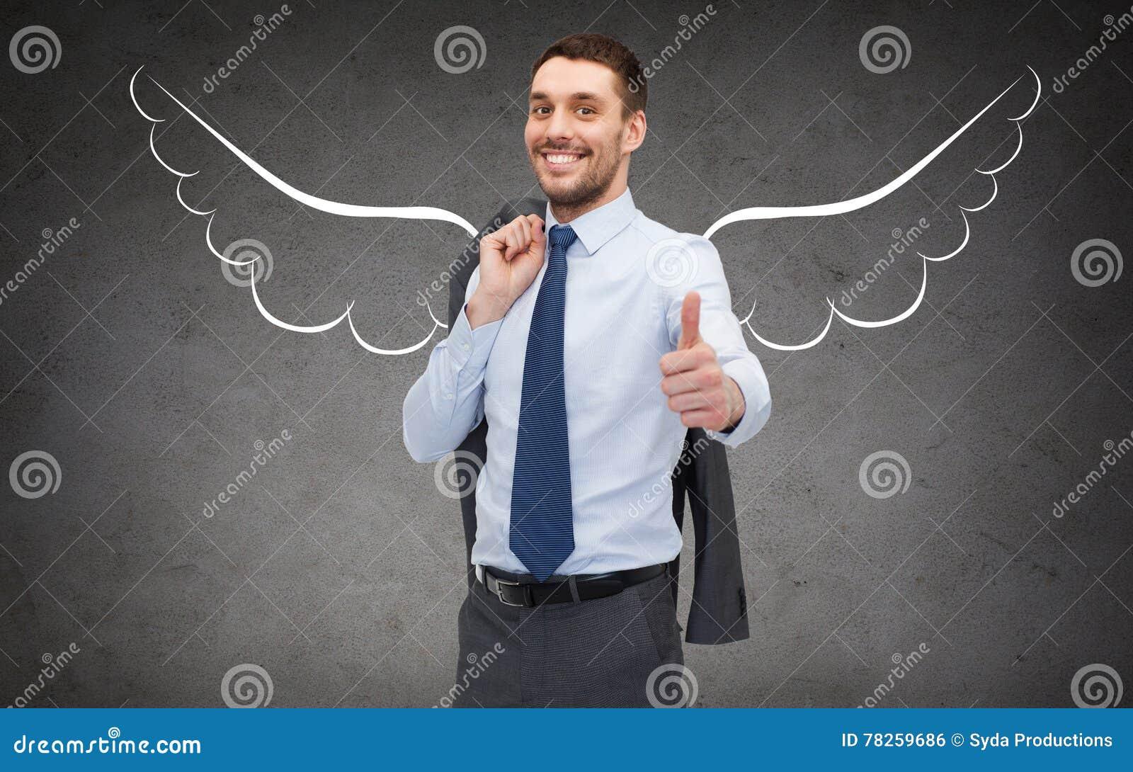 Image D Ange Homme homme d'affaires avec des ailes d'ange montrant des pouces photo