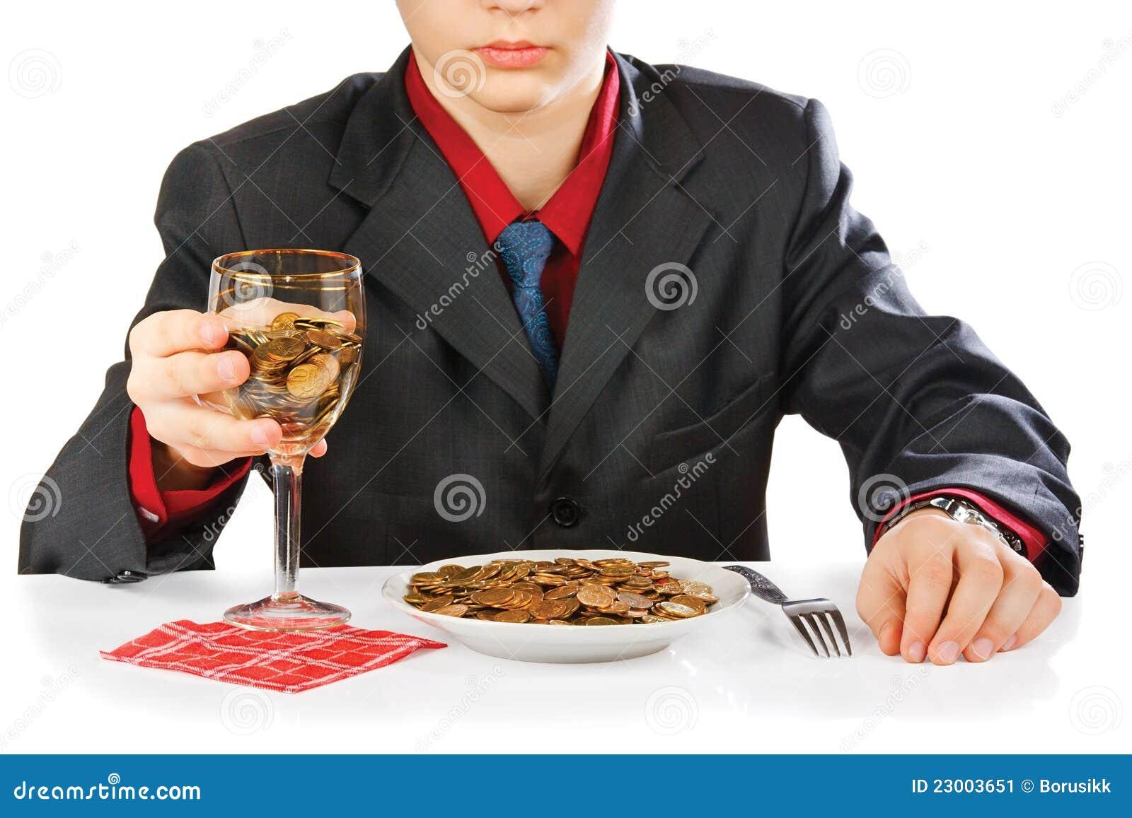 Homme d affaires mangeant l argent