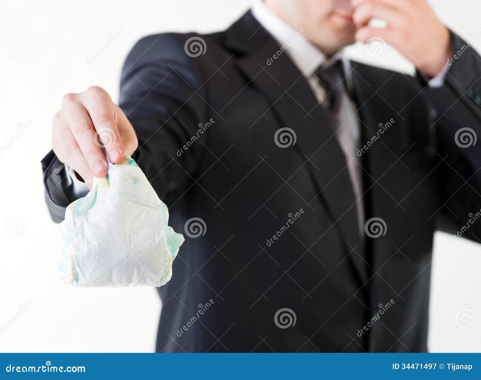 homme d 39 affaires tenant une couche culotte sale image stock image du culotte m le 34471497. Black Bedroom Furniture Sets. Home Design Ideas