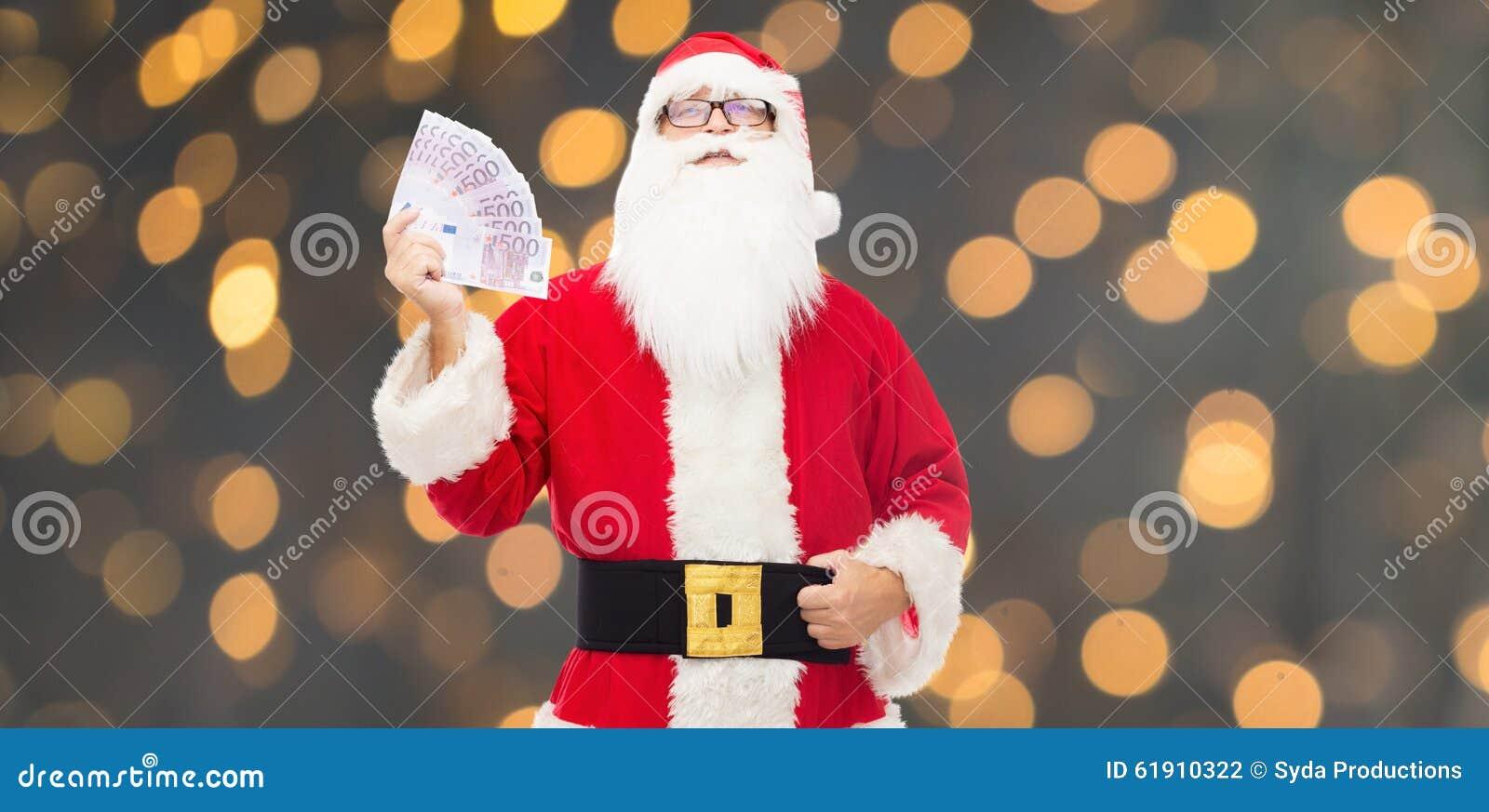 a45e7a462c89b Homme Dans Le Costume Du Père Noël Avec L'euro Argent Photo stock ...