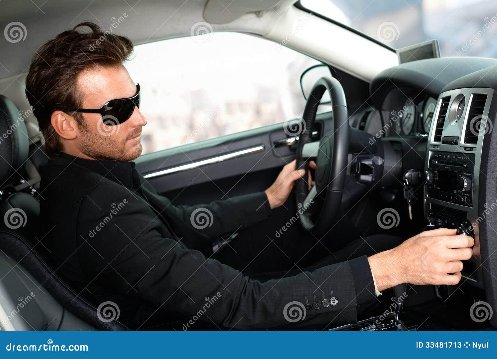 homme dans le noir dans la voiture de luxe image stock image du coute jupe 33481713. Black Bedroom Furniture Sets. Home Design Ideas