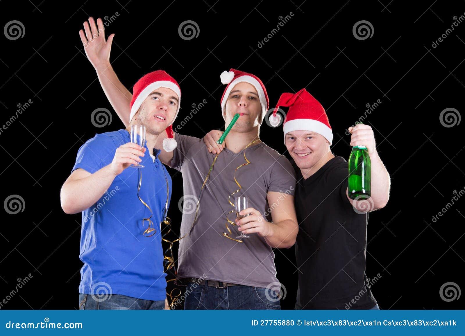 Homme trois utilisant le chapeau de Santa