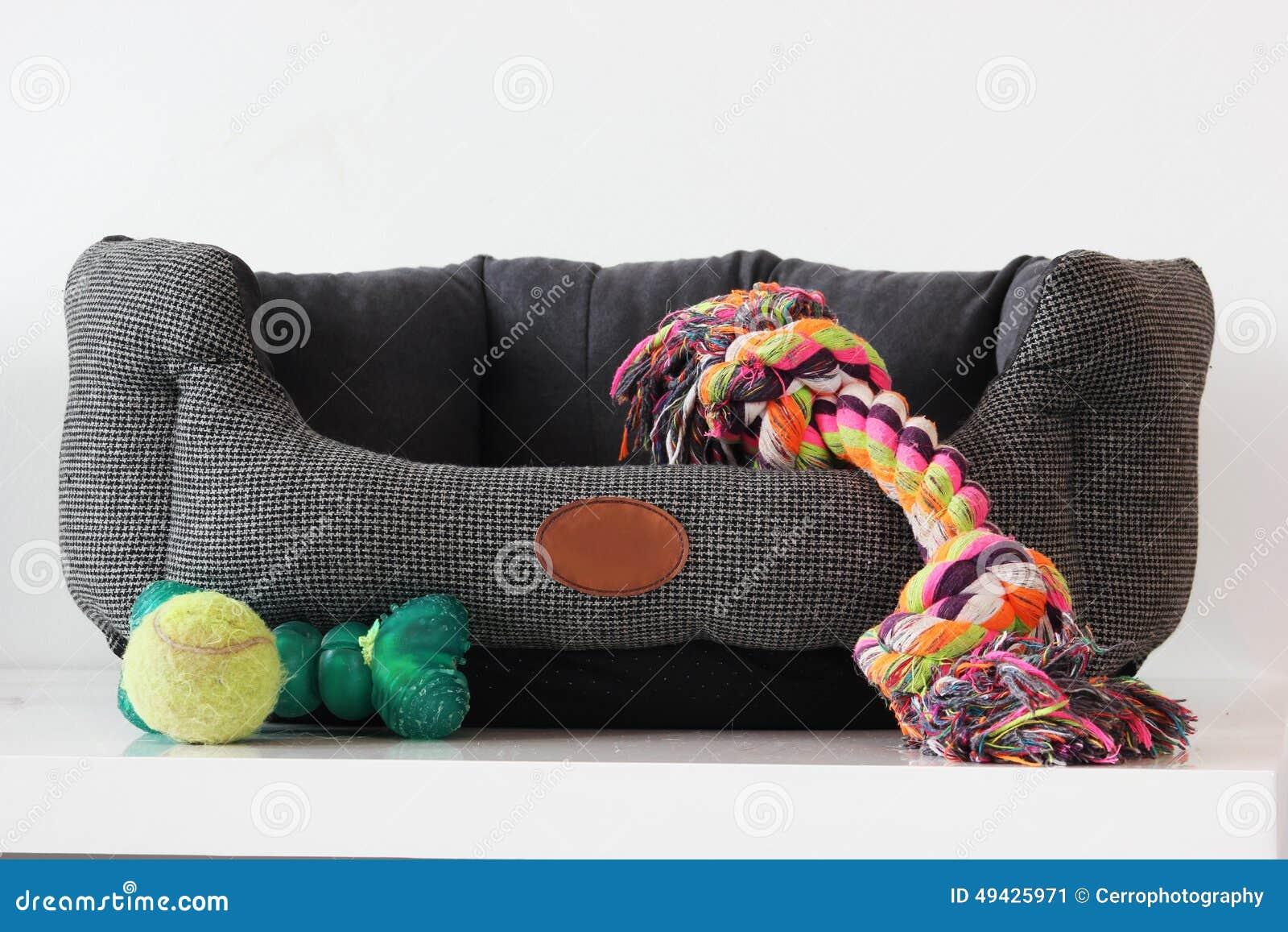 Hondmand met speelgoed