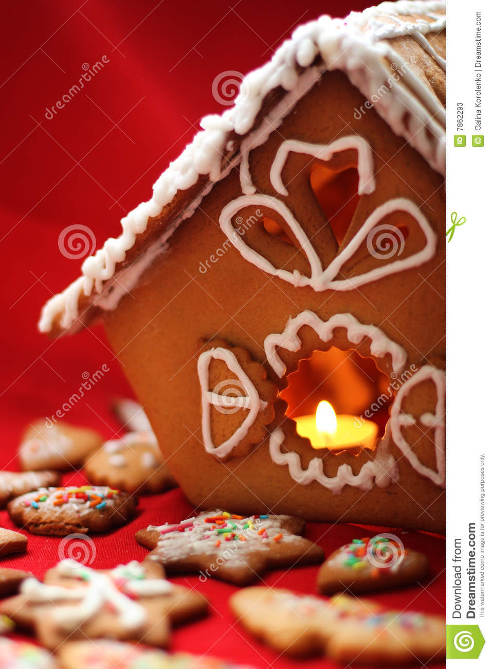 Honey cake house with a candle close up