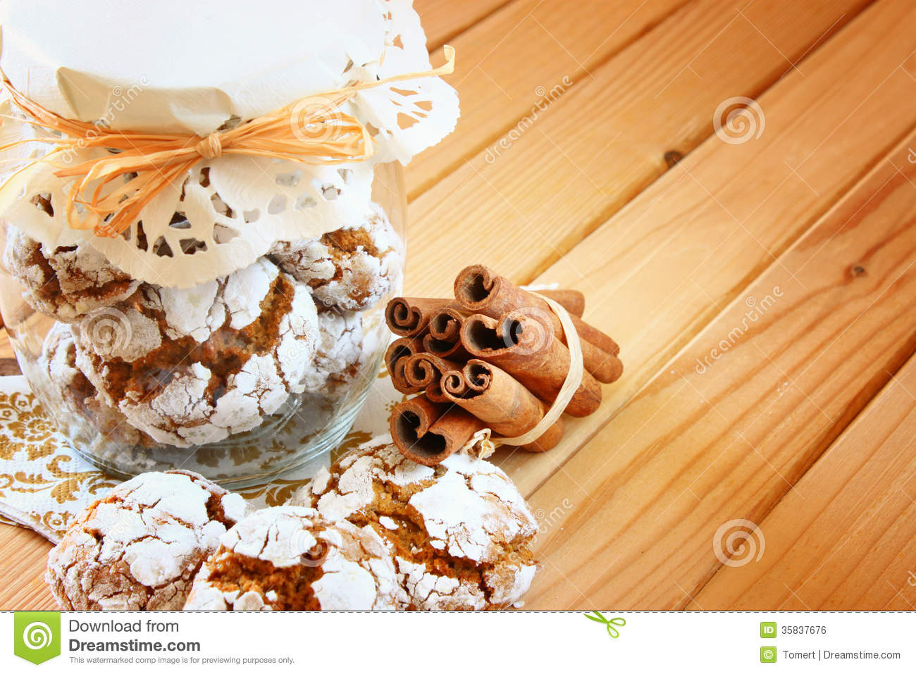 Honey Cakes Cookie Jar And Cinnamon Sticks On Wooden Table Stock