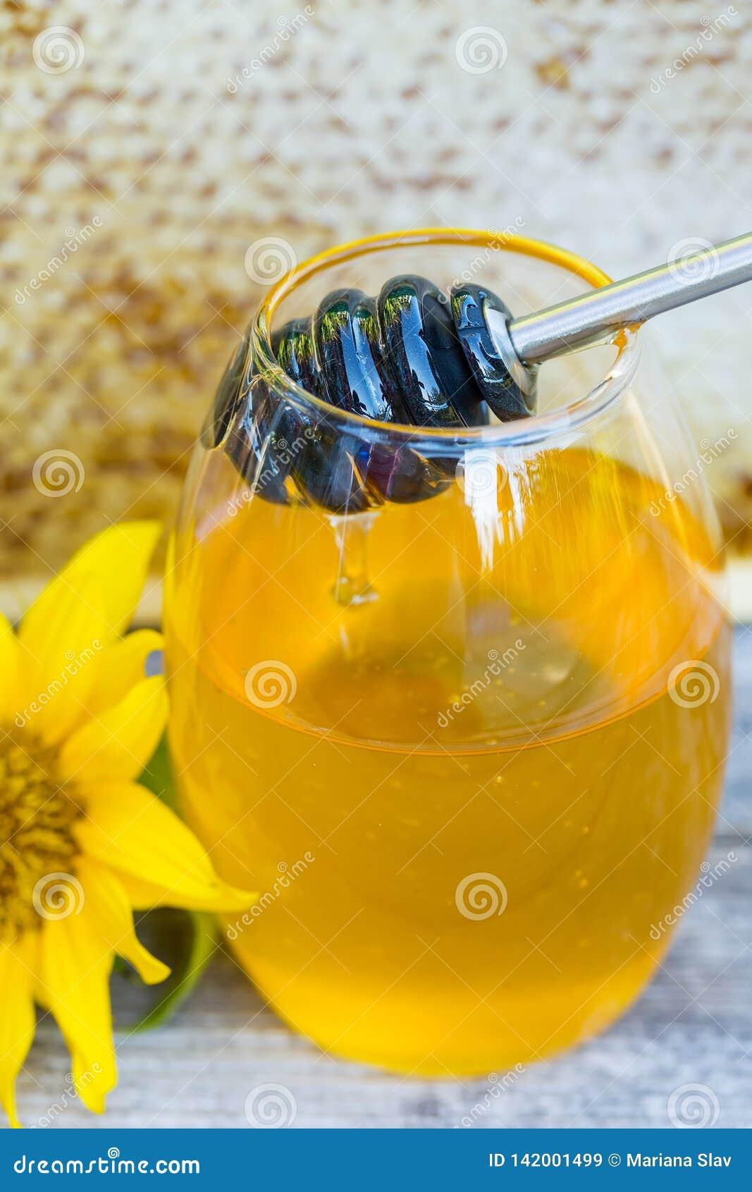 Honey dripping in a jar