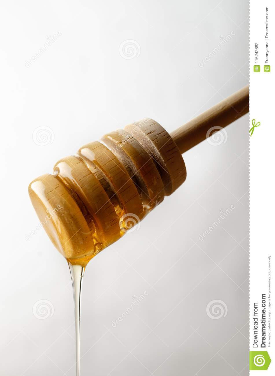 Honey Dripping from Wooden Drizzler