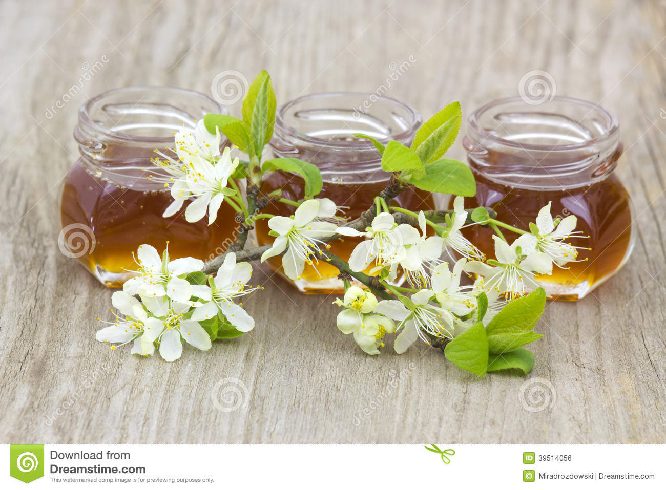Honey in jars and flowers