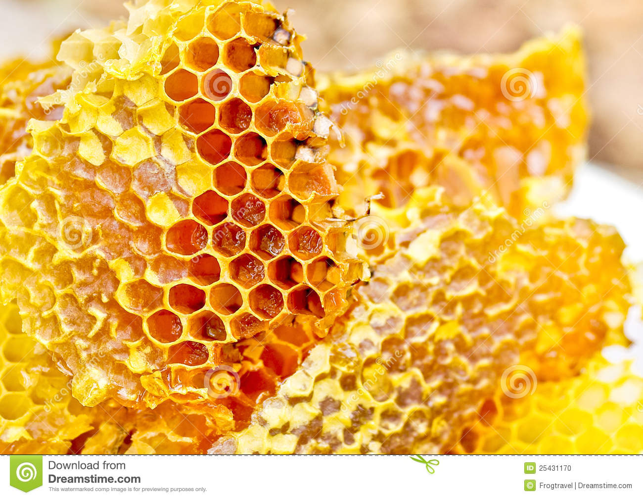 background - beekeeping produce. Bee honeycombs wax with honey. Honey ...