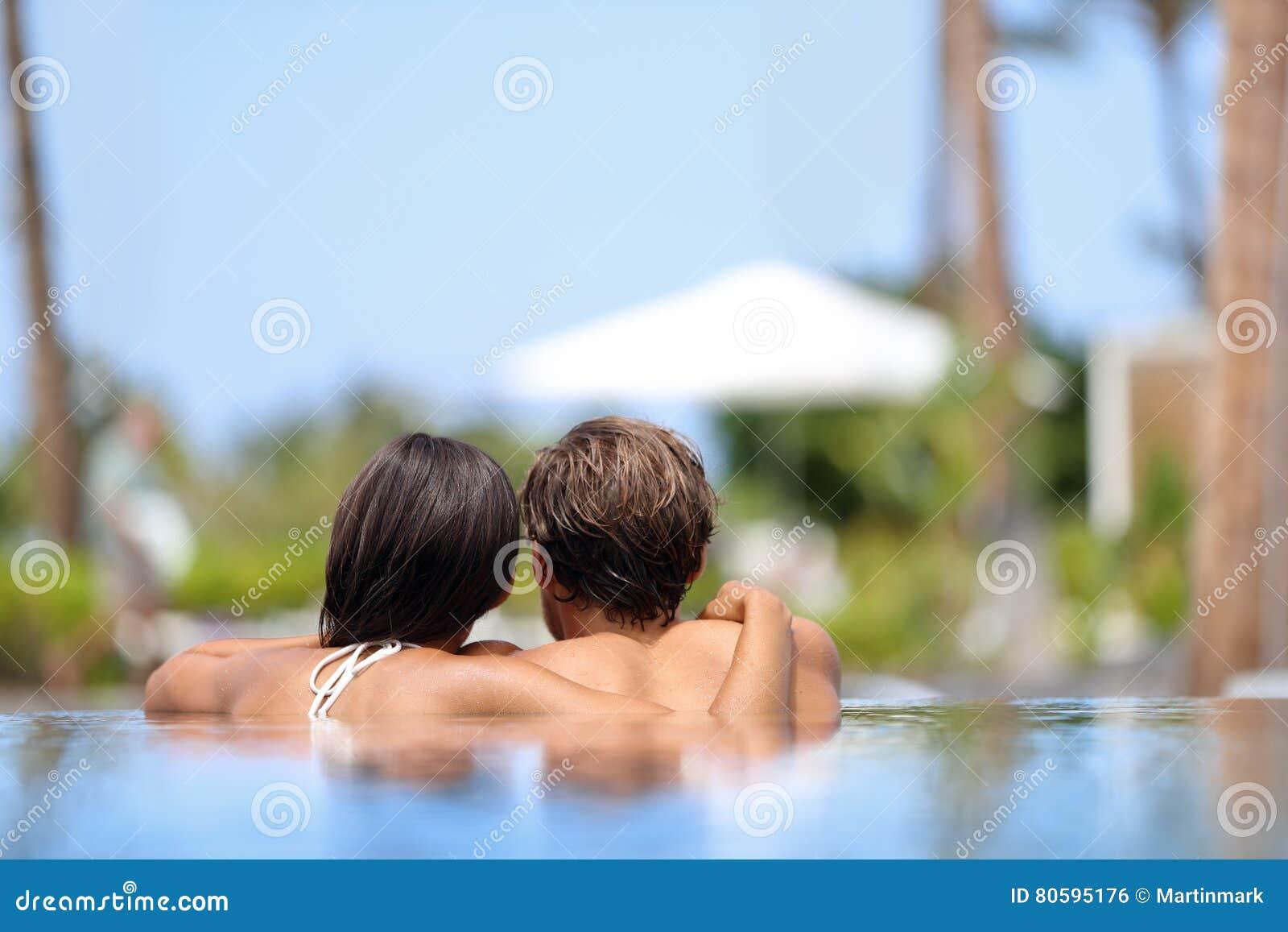 Honeymoon couple relaxing together - swimming pool
