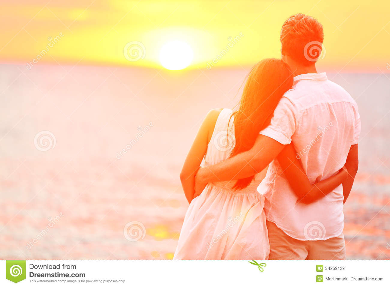 Honeymoon couple romantic in love at beach sunset