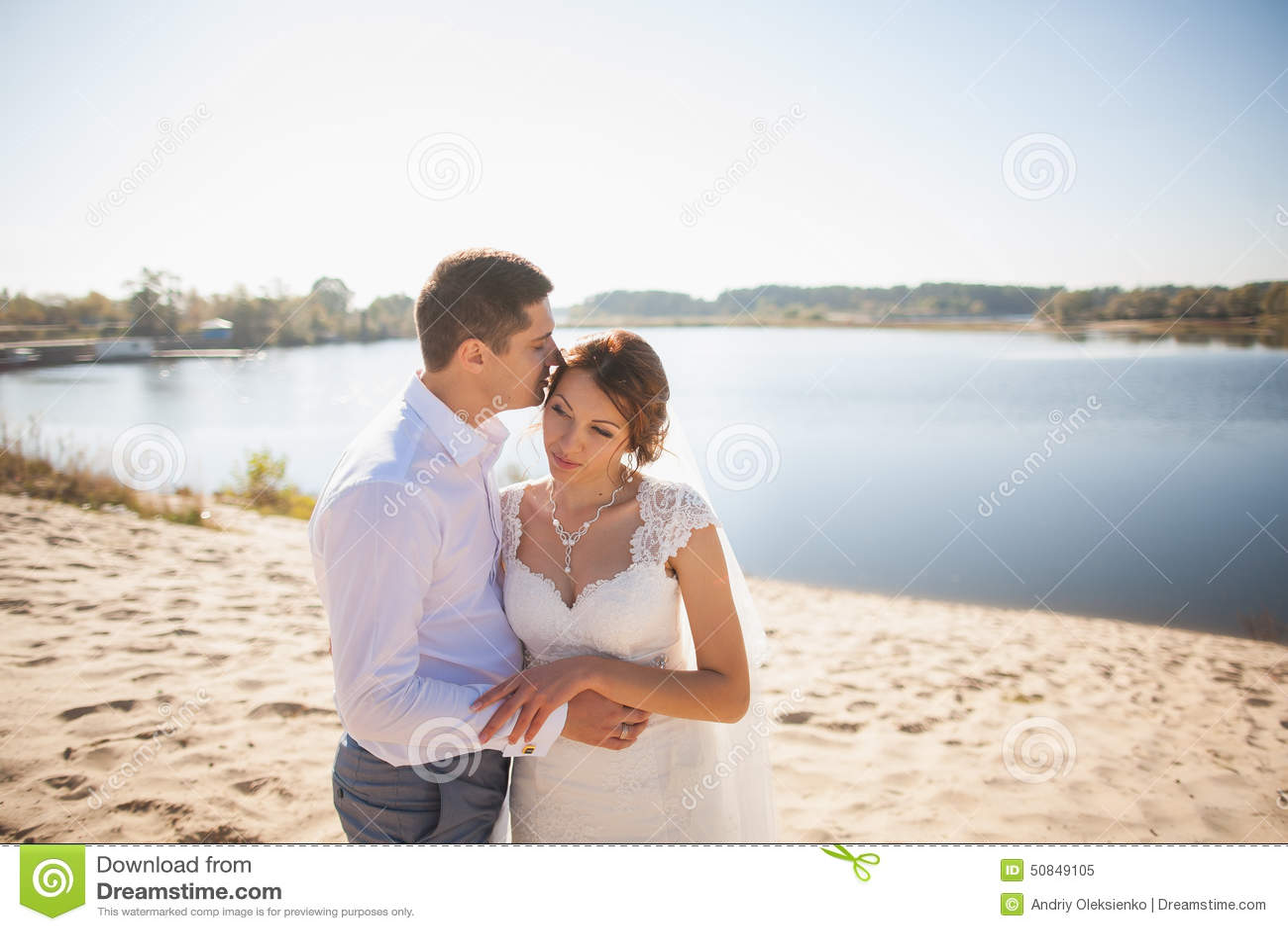 Honeymoon of just married wedding couple happy bride for Honeymoon on the beach
