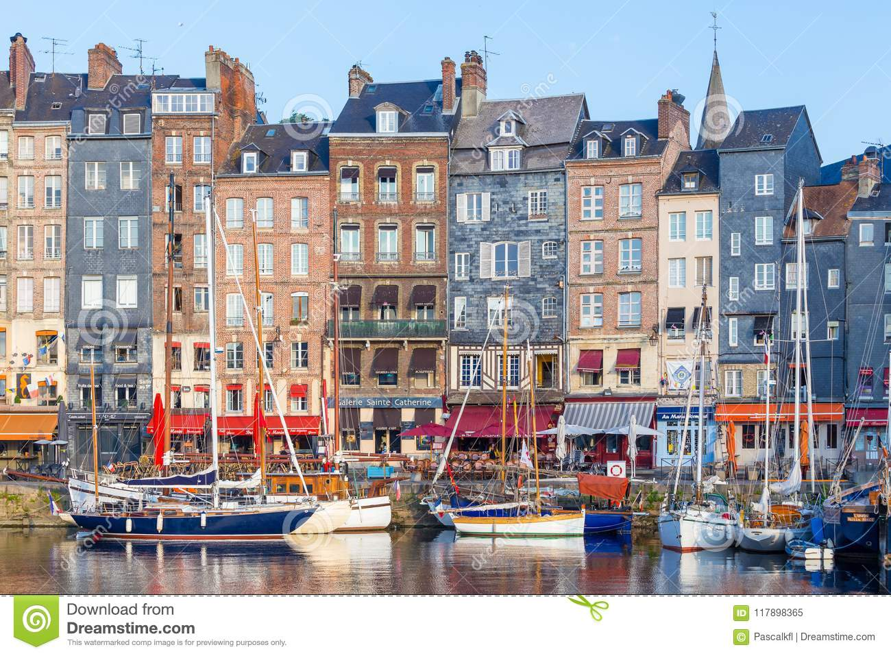 Honfleur, France - August 31, 2016: Picturesque old harbour at the Normandy village of Honfleur France with boats and cafes