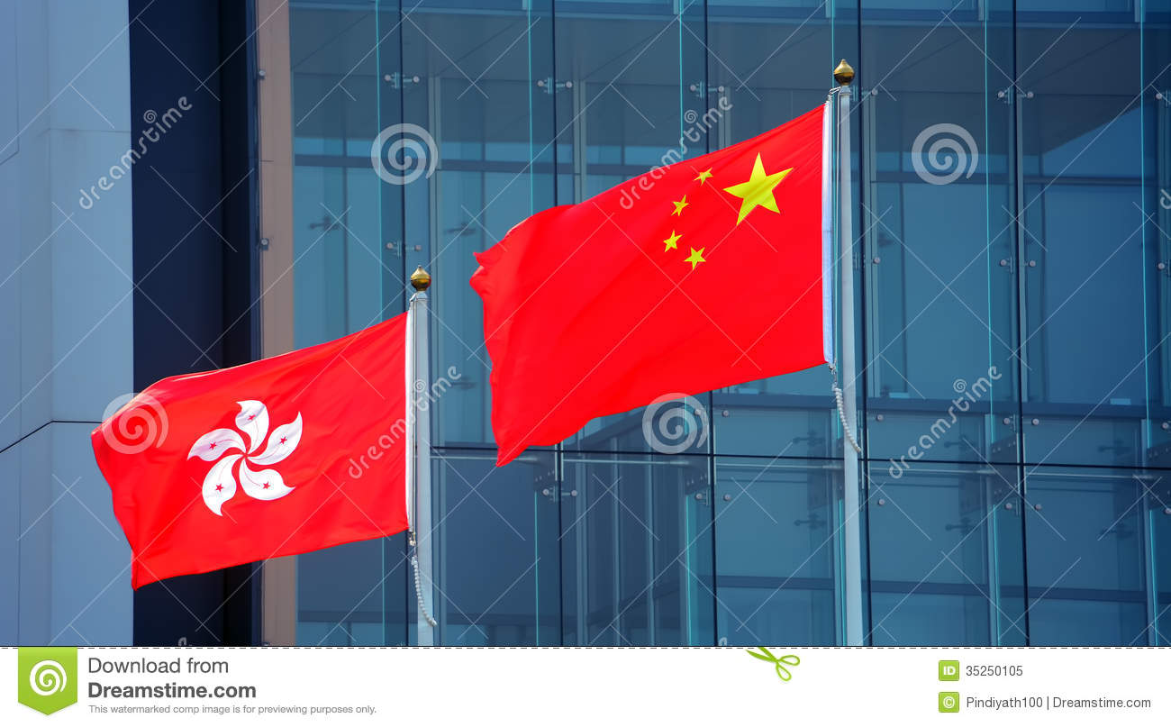 Wind Blowing On Building : Hong kong and china flags royalty free stock photo image