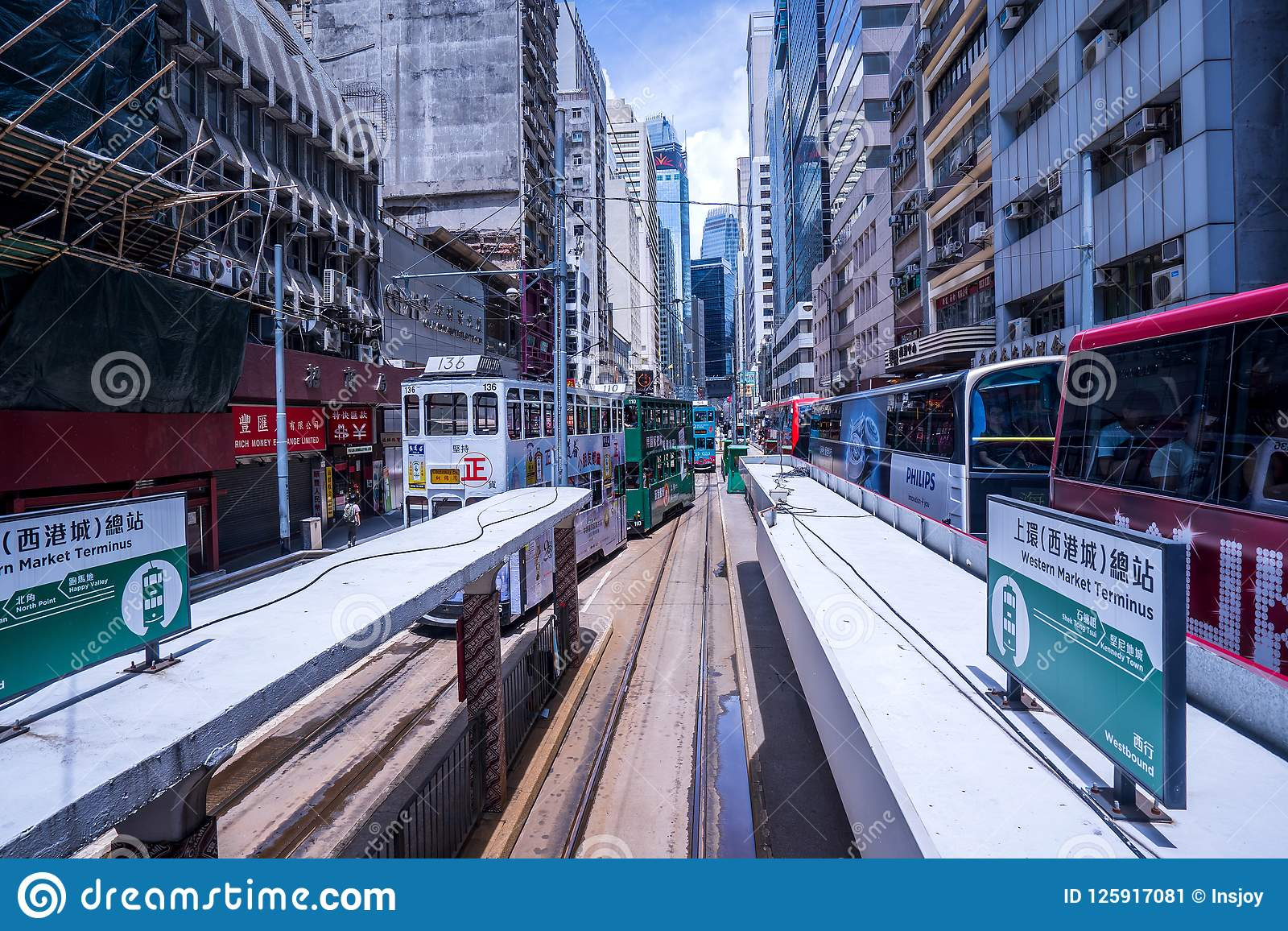 Hong Kong tramways, Hong Kong`s trams run in two directions -- east and west. Passengers lean back as a Hong Kong tram