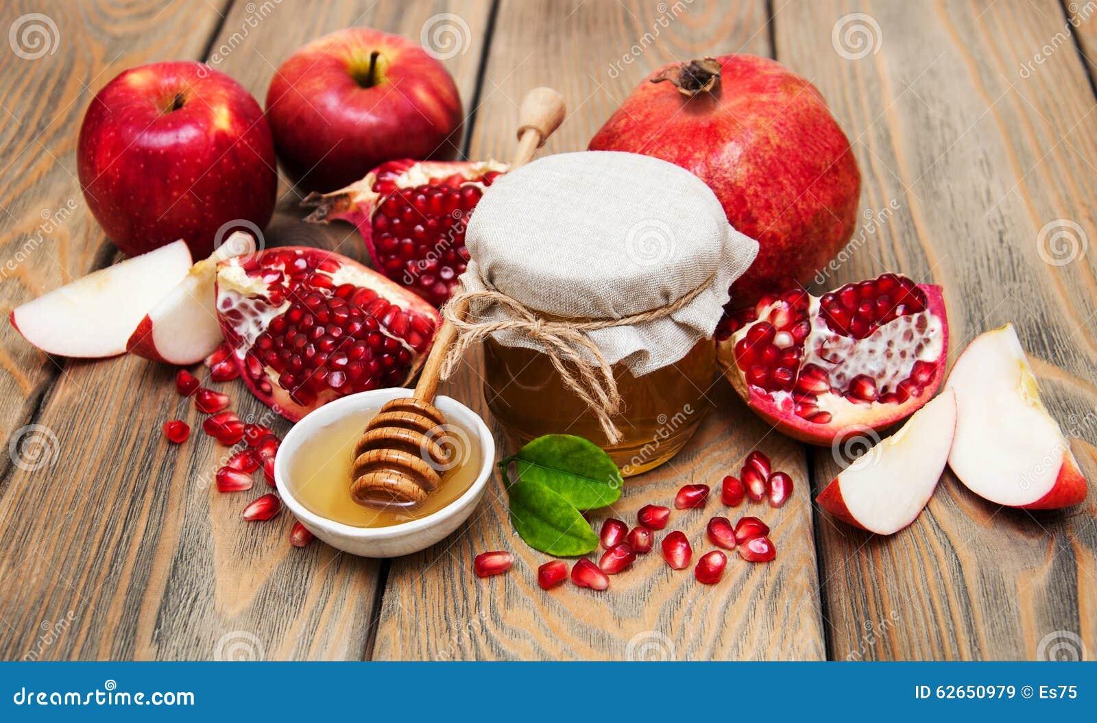 Honig mit Granatapfel und Äpfeln