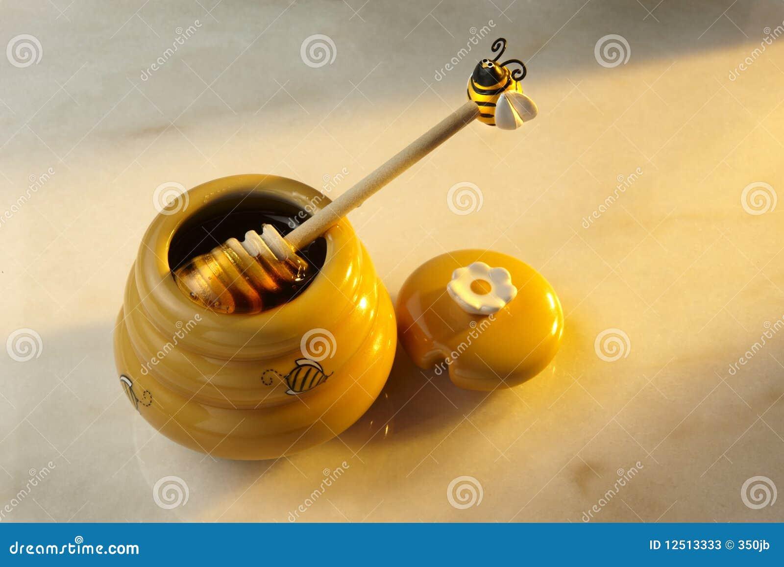 Honigglas und Honig Dripper
