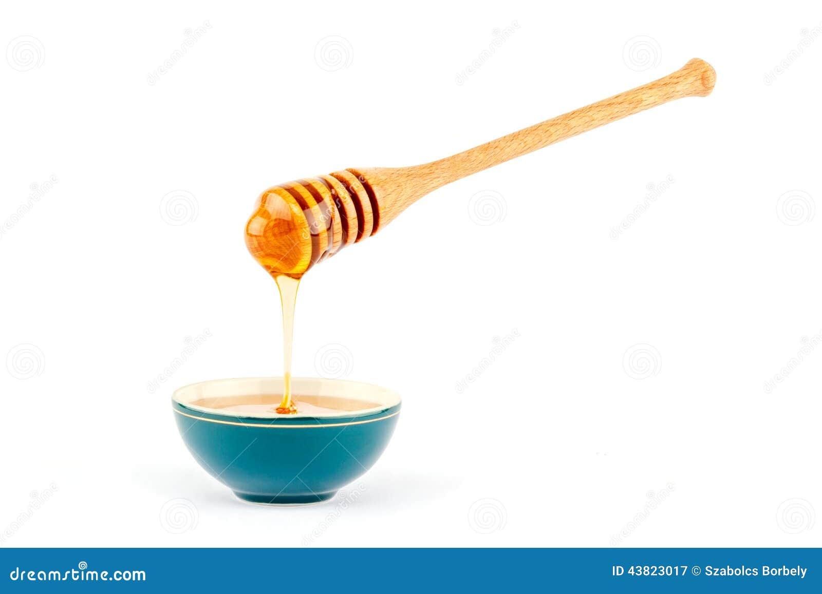 Honing die van dipper in een kom stromen