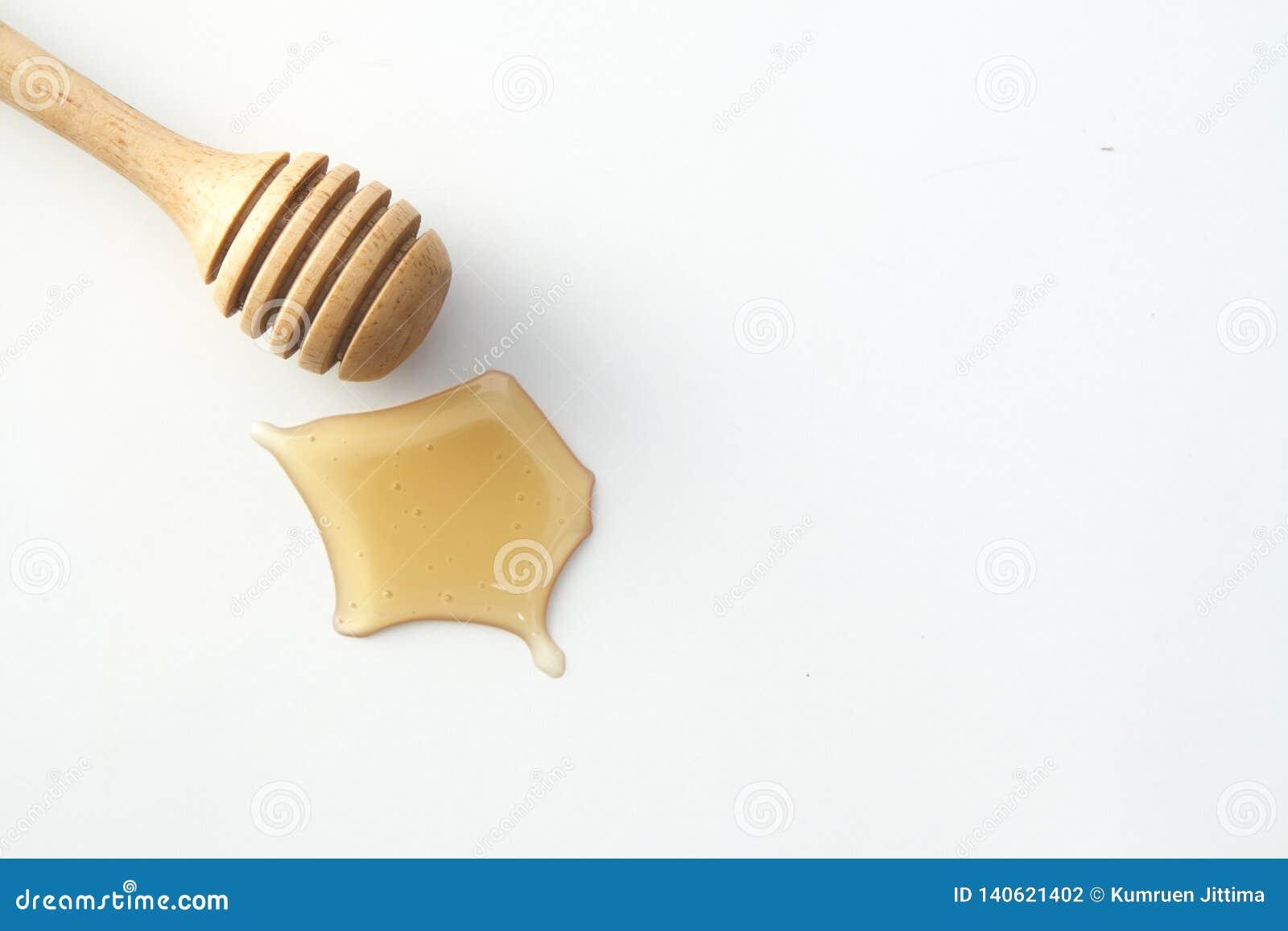 Honingsdipper en honingsfles
