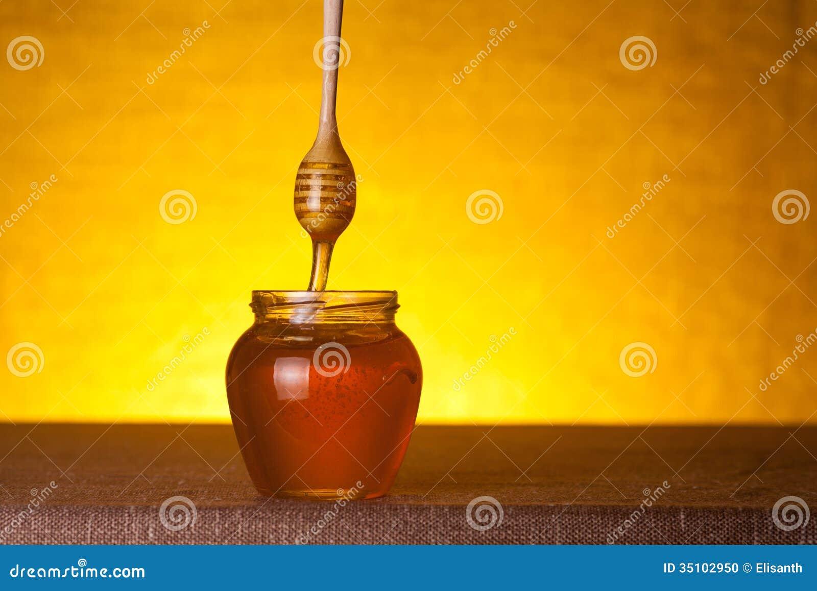 Honingskruik met houten dipper
