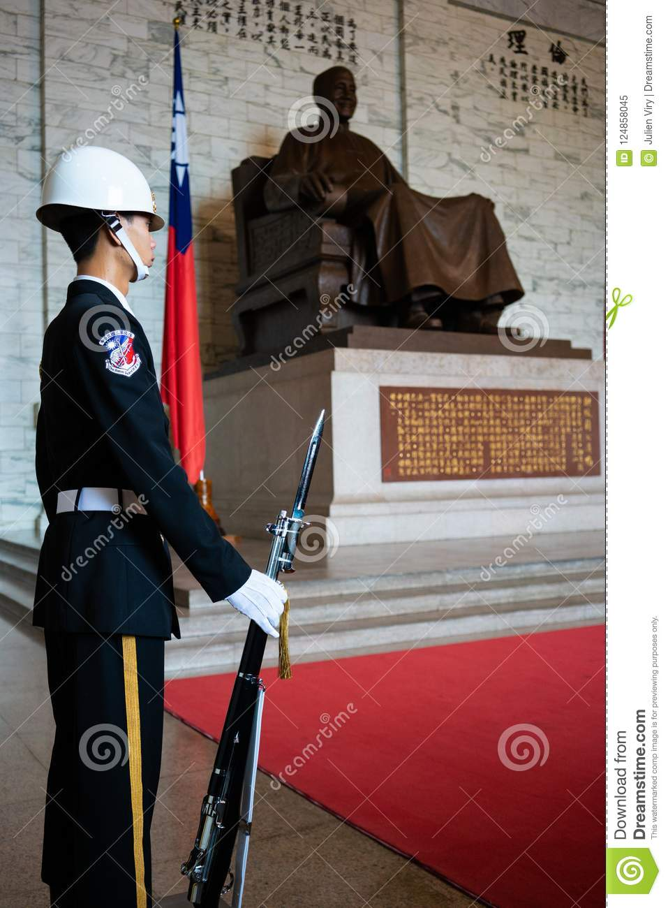 Honor guard with rifle and bayonet in front of statue at National Chiang Kai-shek memorial hall in Taipei Taiwan