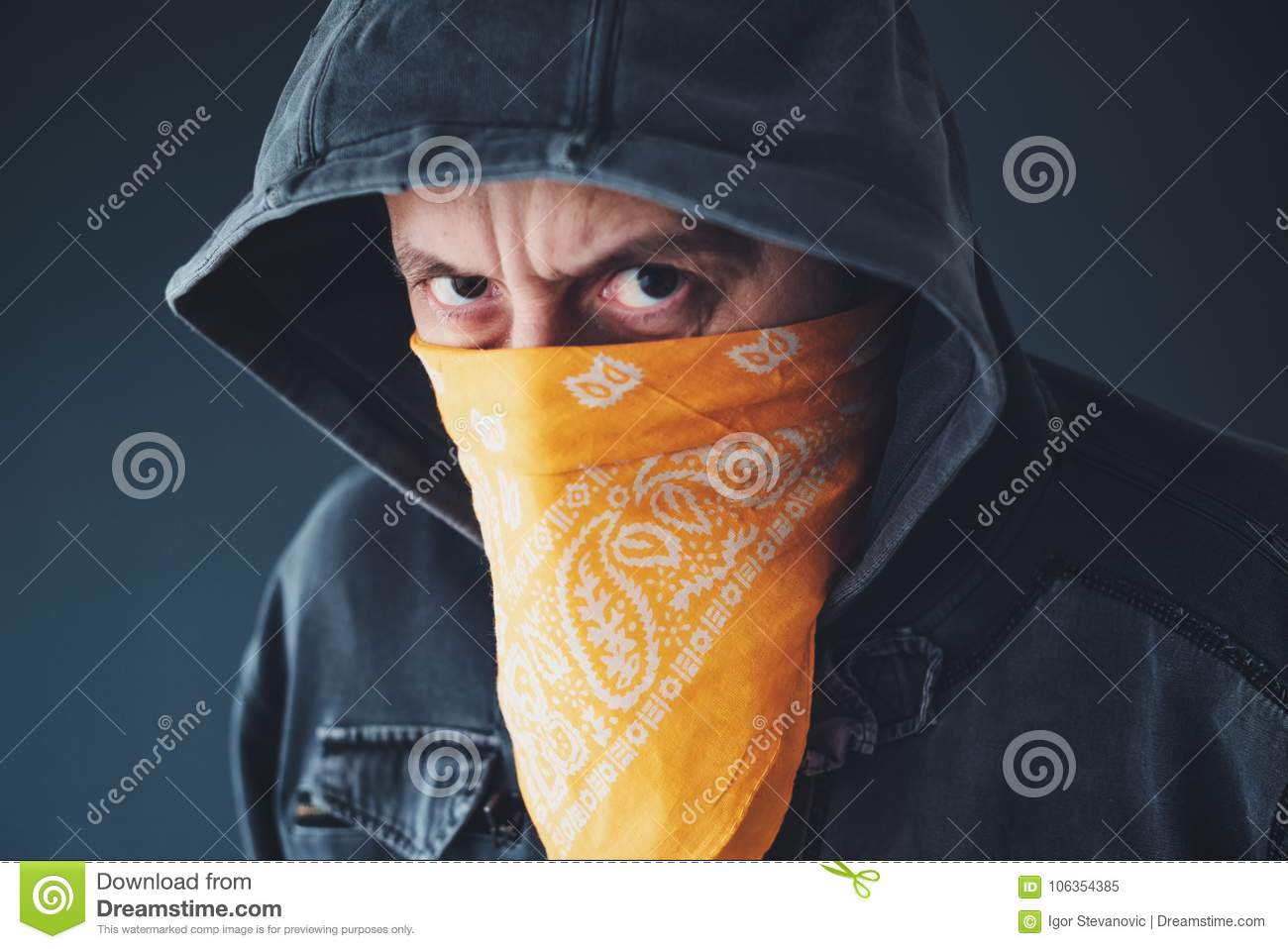 Hooded gang member criminal with scarf over face